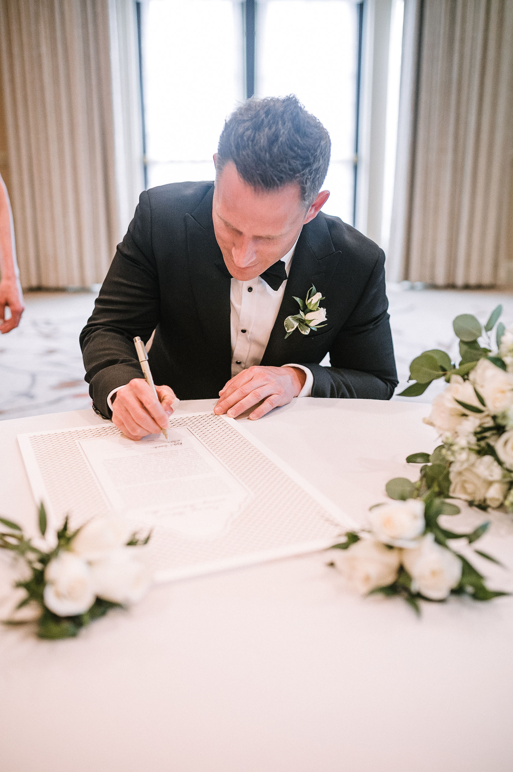 groom signing the ketubah at The Salamander Resort