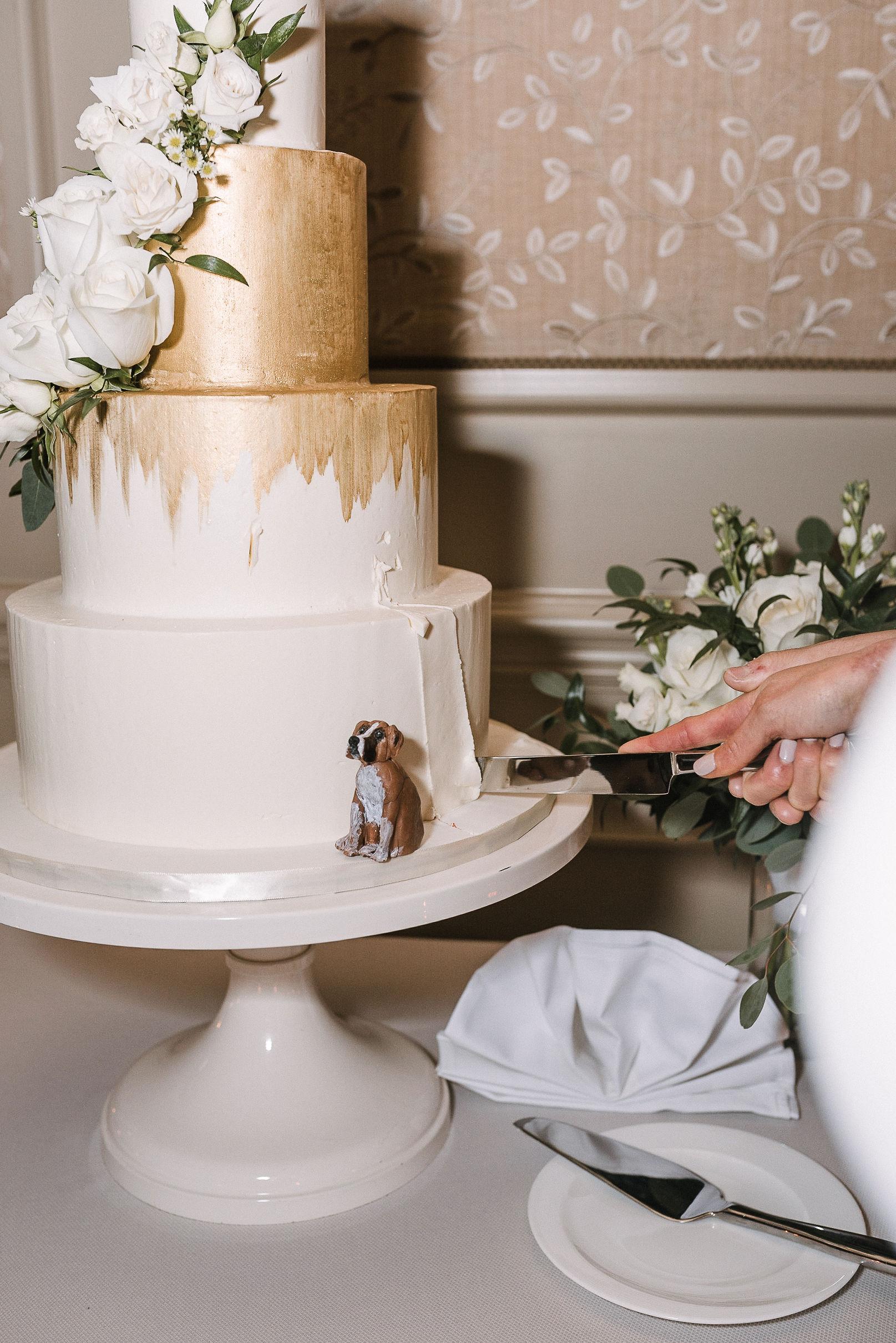 bride and groom cutting cake at the Salamander Resort