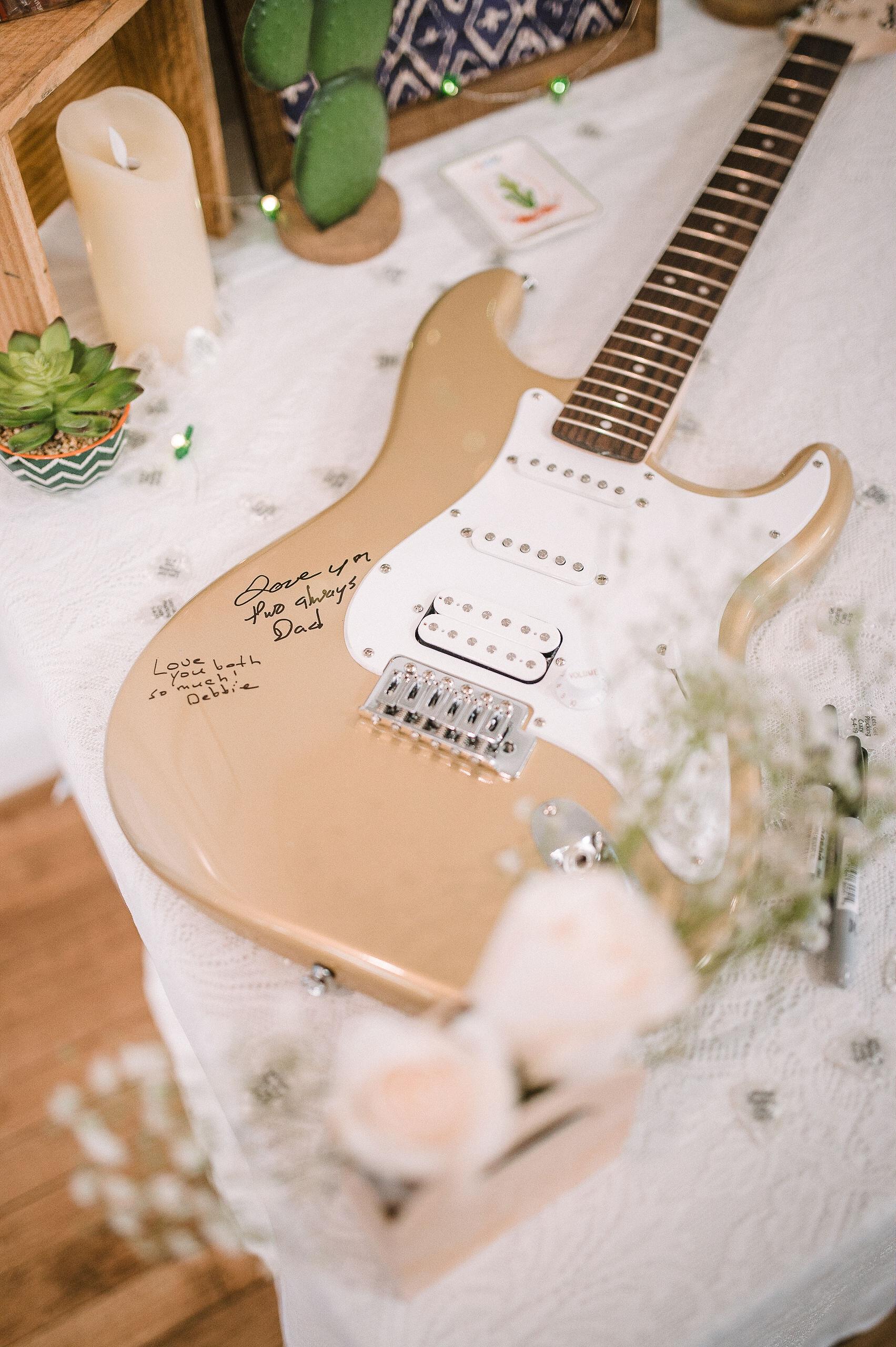 reception guitar details for wedding reception at MAVFC Reception Hall
