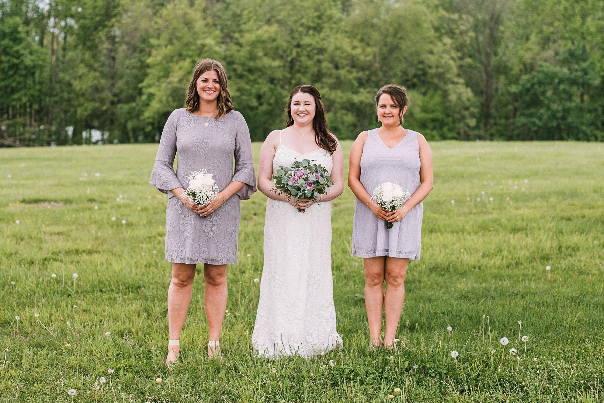 bride and bridesmaids smiling at MAVFC Reception Hall