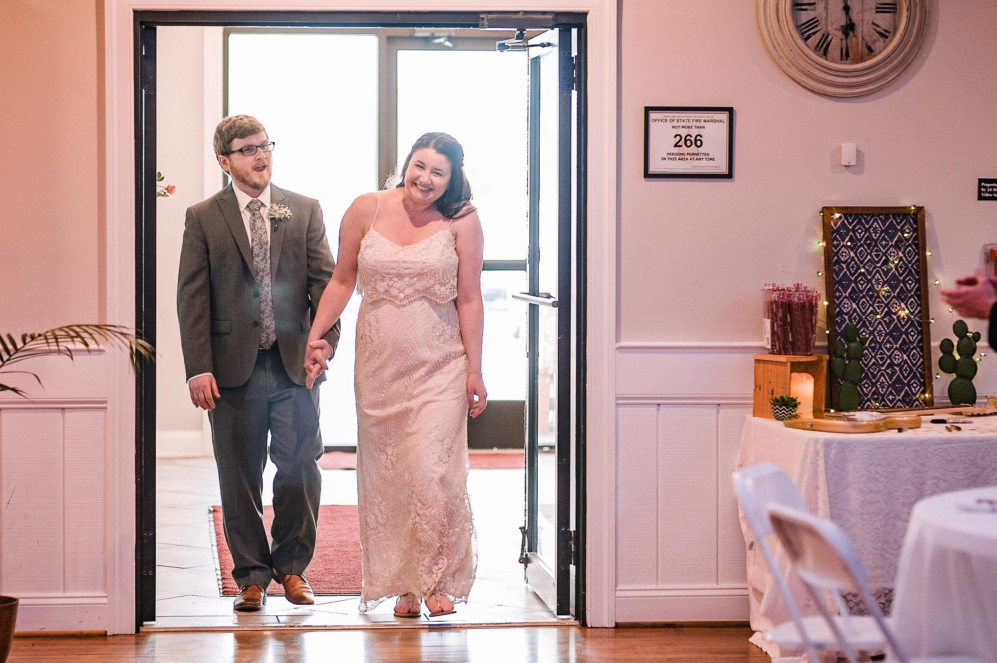 bride and groom entering reception at MAVFC Reception Hall