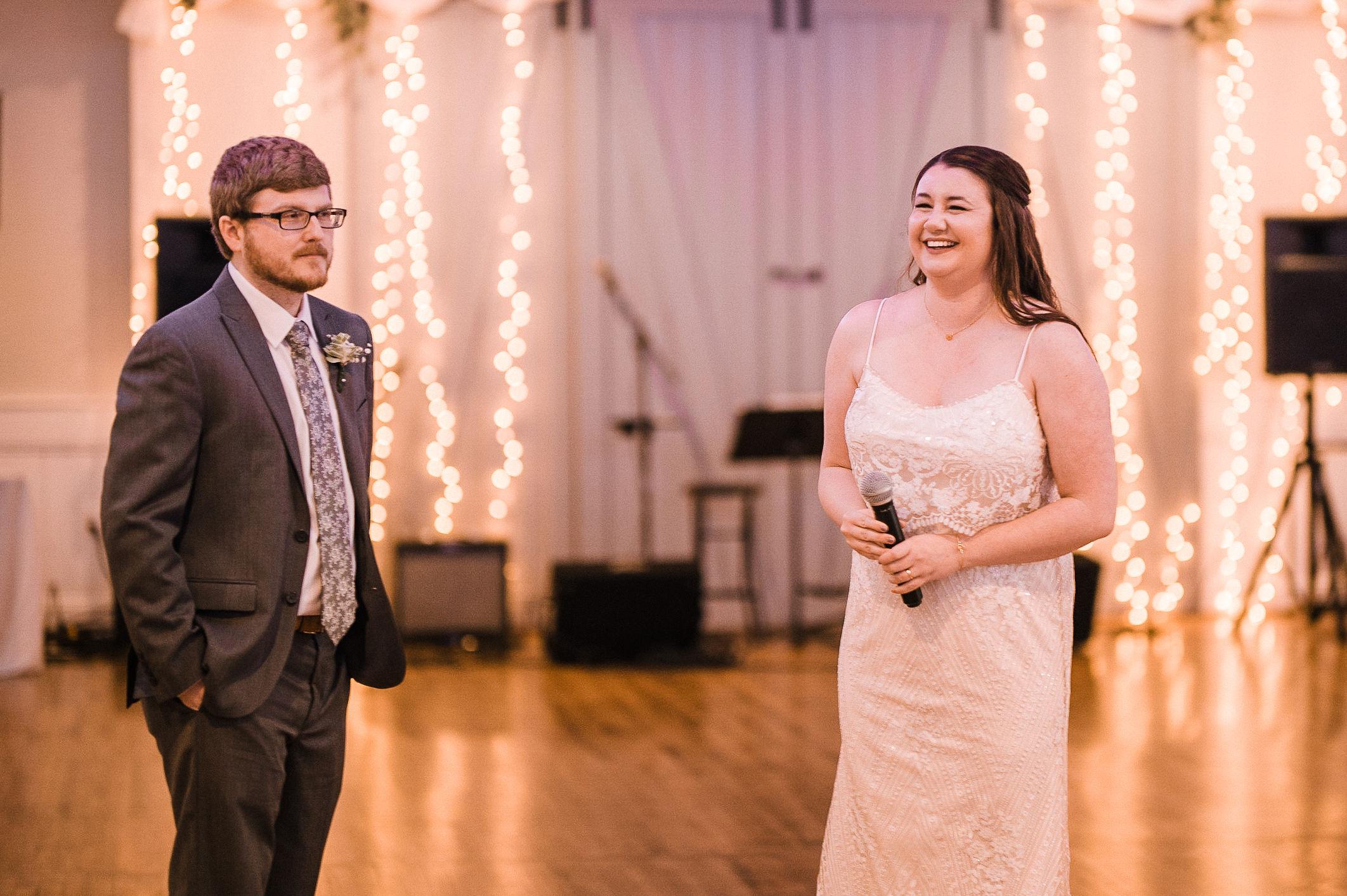 bride and groom giving speech at reception at MAVFC Reception Hall