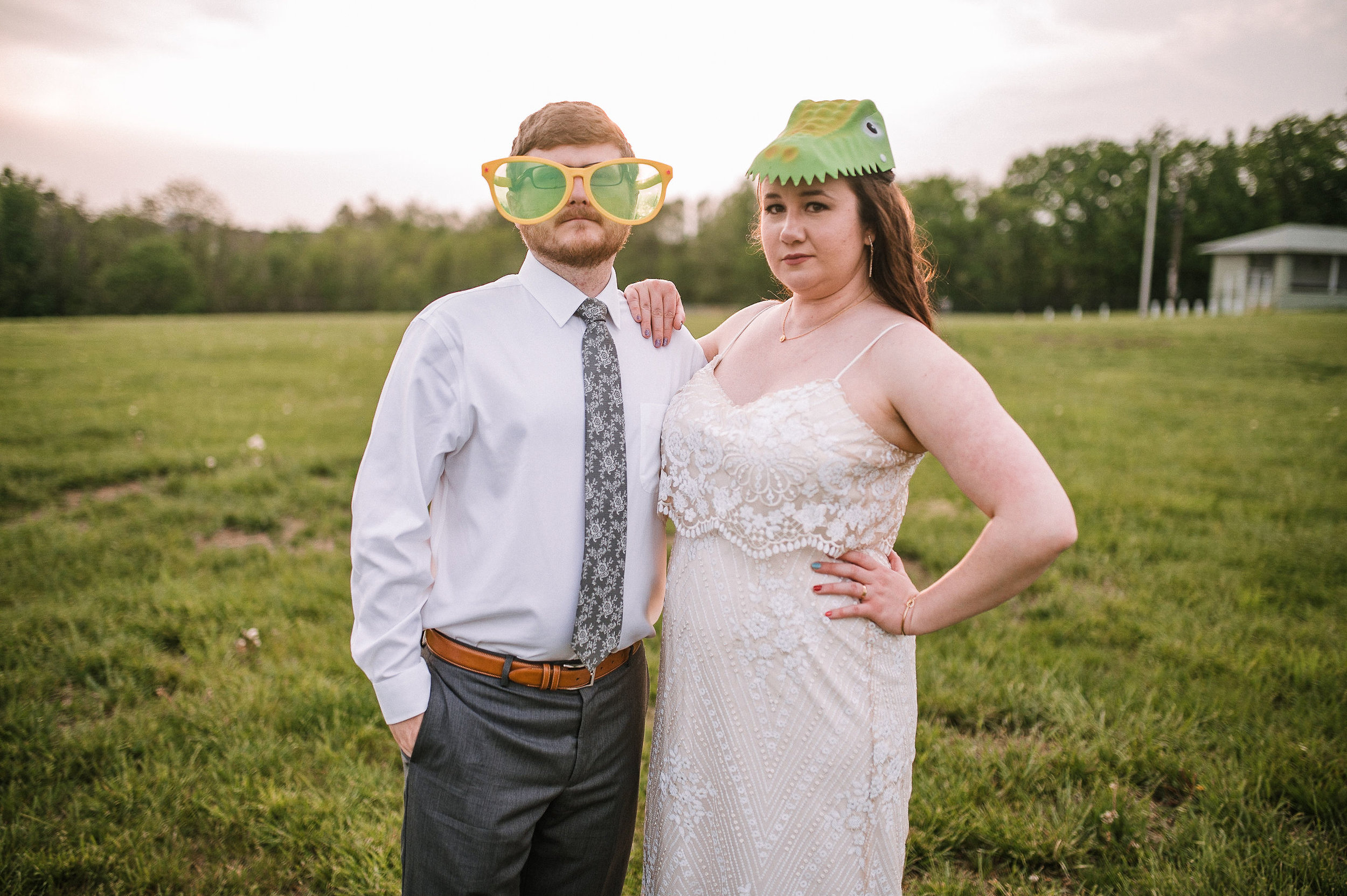 bride and groom wearing photo booth attire at MAVFC Reception Hall