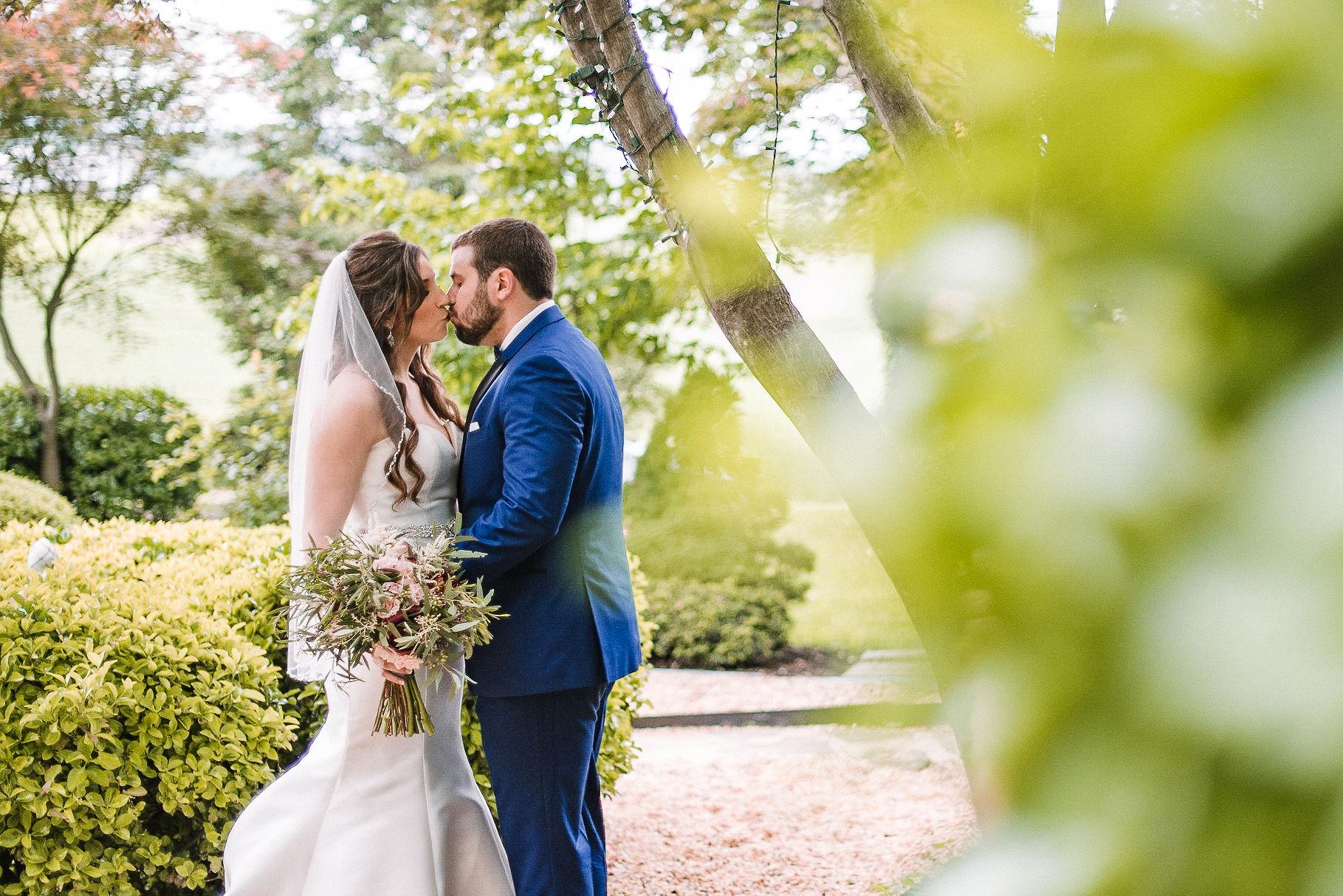 bride and groom kissing at Seasons at Magnolia Manor