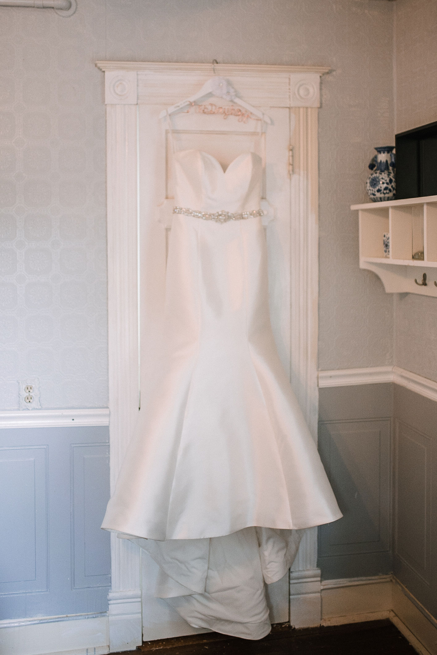 bride's wedding dress hanging up at Seasons at Magnolia Manor