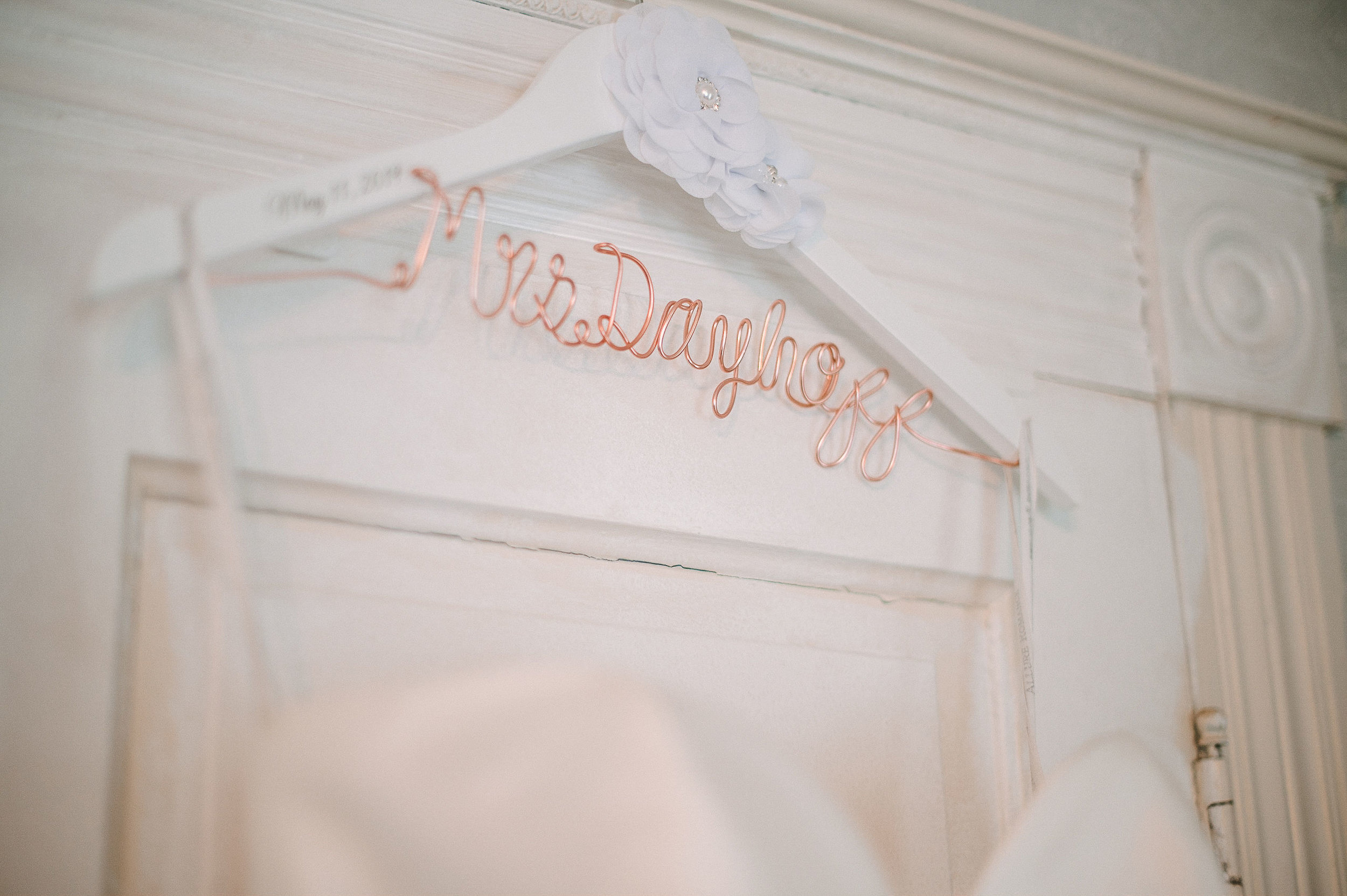 bride's wedding dress hanger detail shot at Seasons at Magnolia Manor