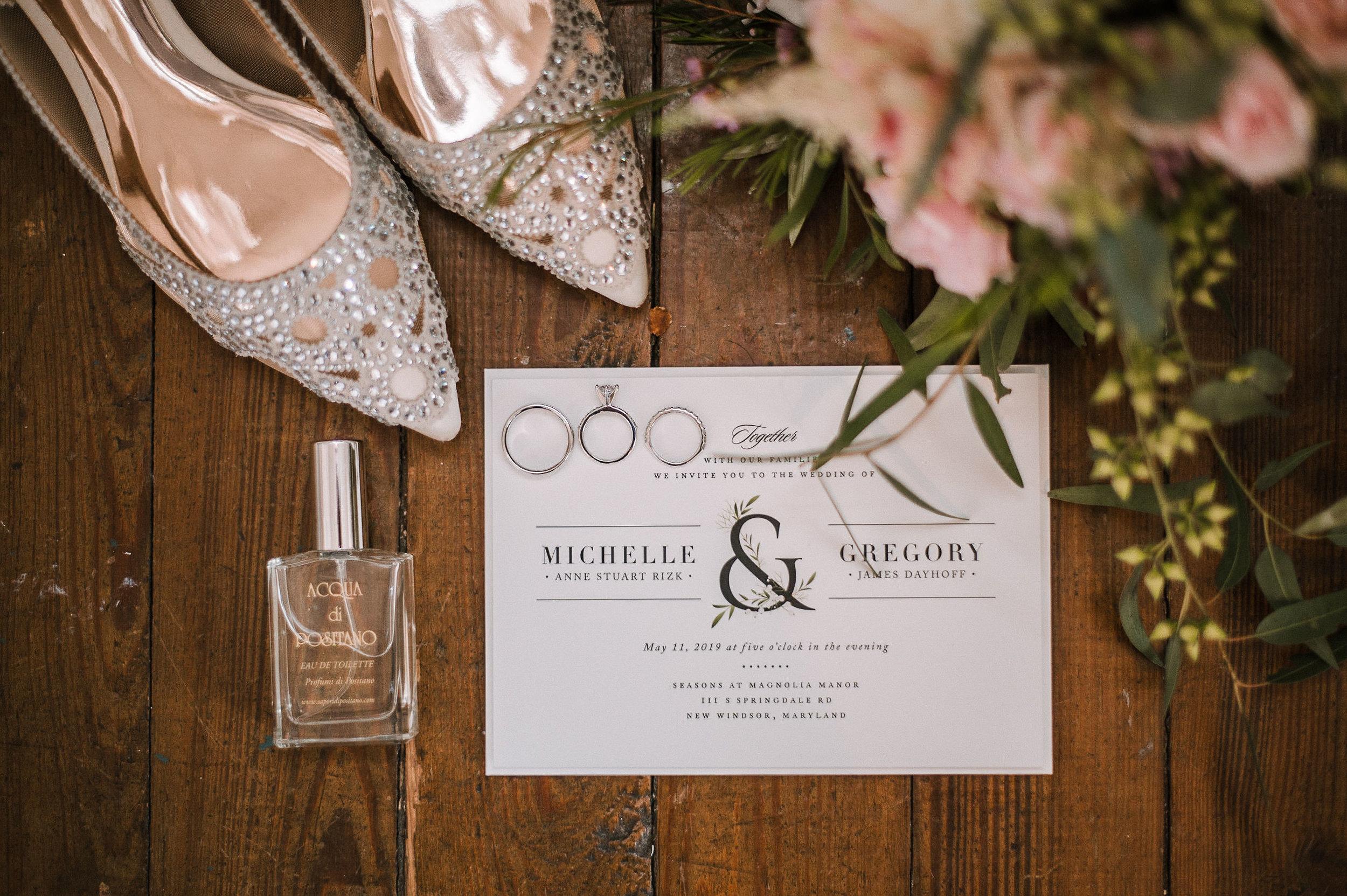 detail shot of wedding stationery, shoes, and rings at Seasons at Magnolia Manor