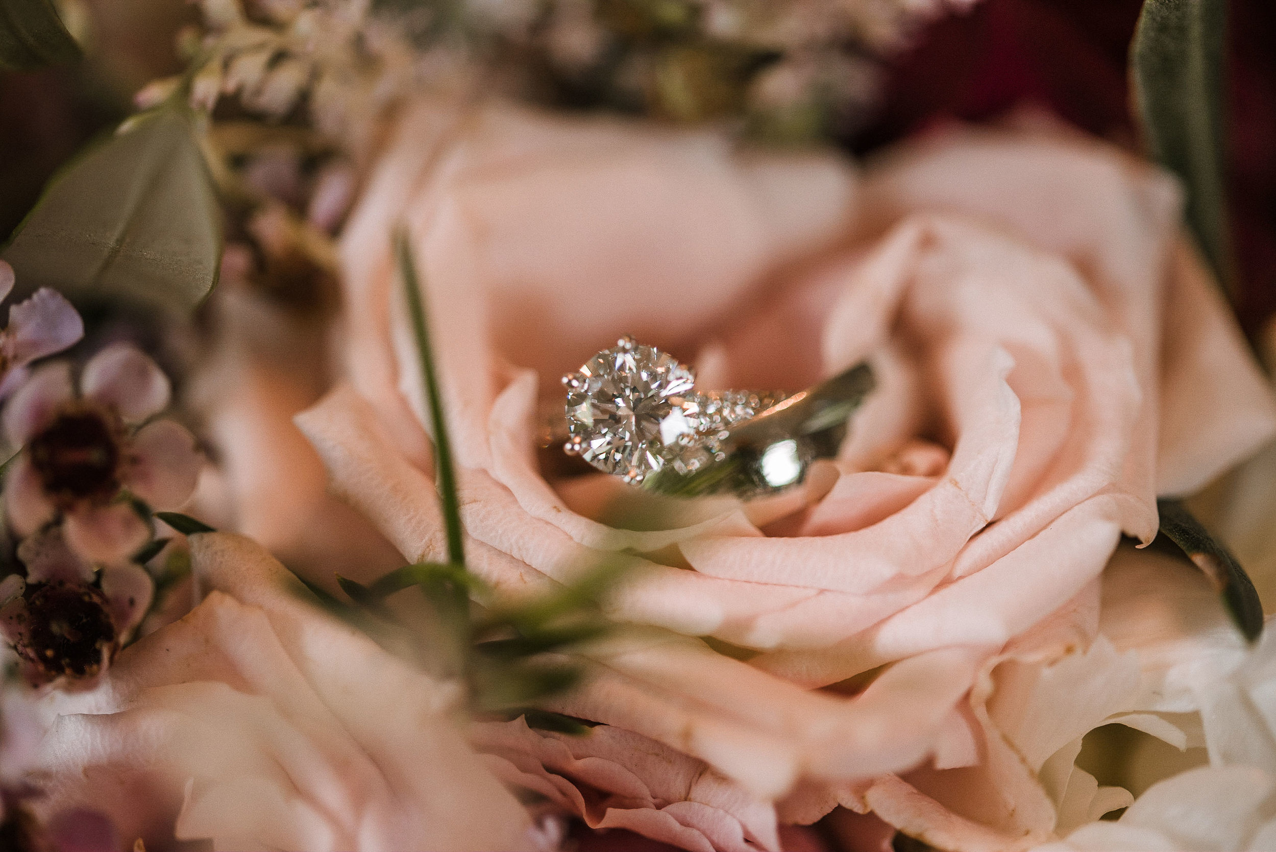 detail shot of wedding rings inside flowers at Seasons at Magnolia Manor