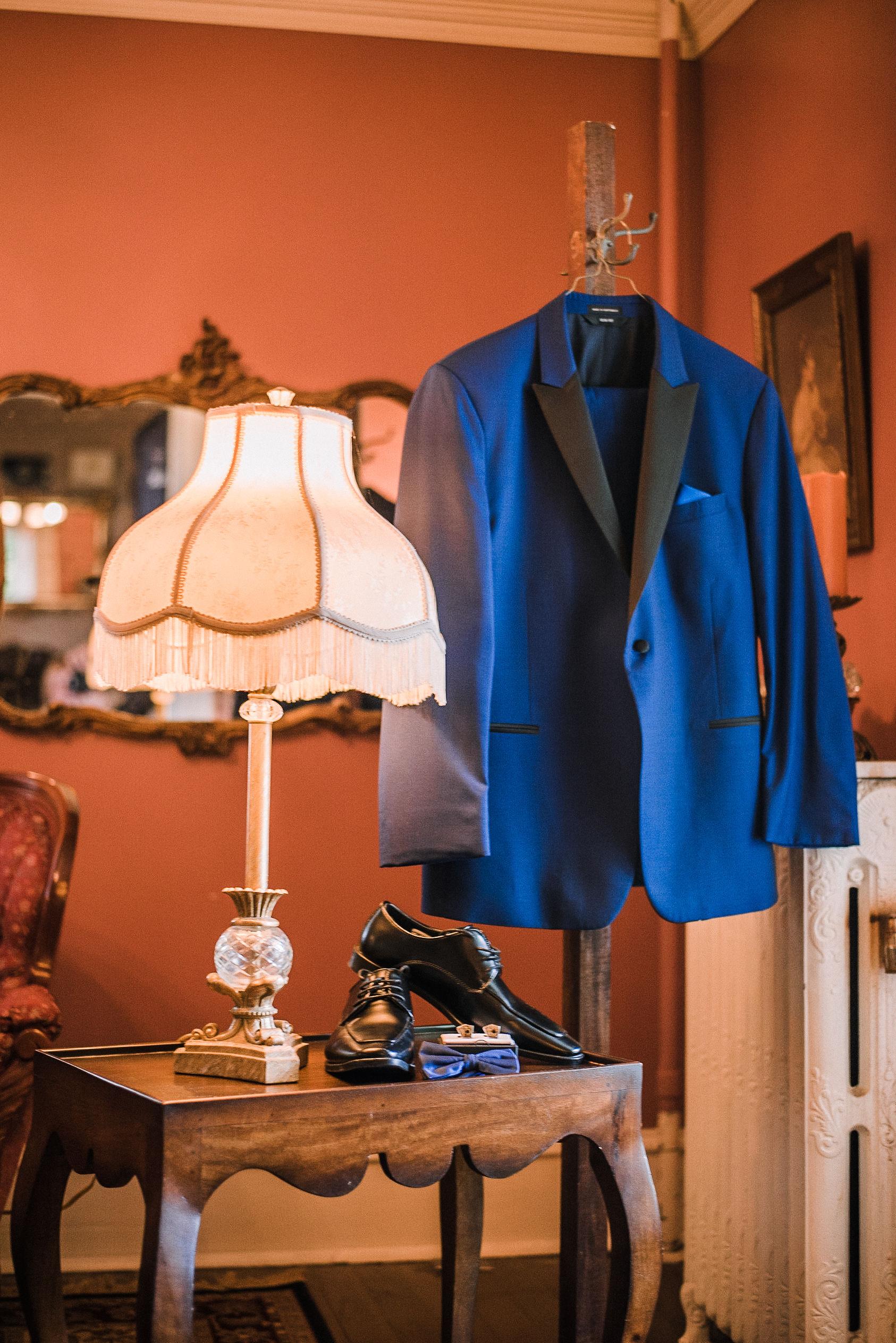 detail shot of groom's jacket hanging up at Seasons at Magnolia Manor
