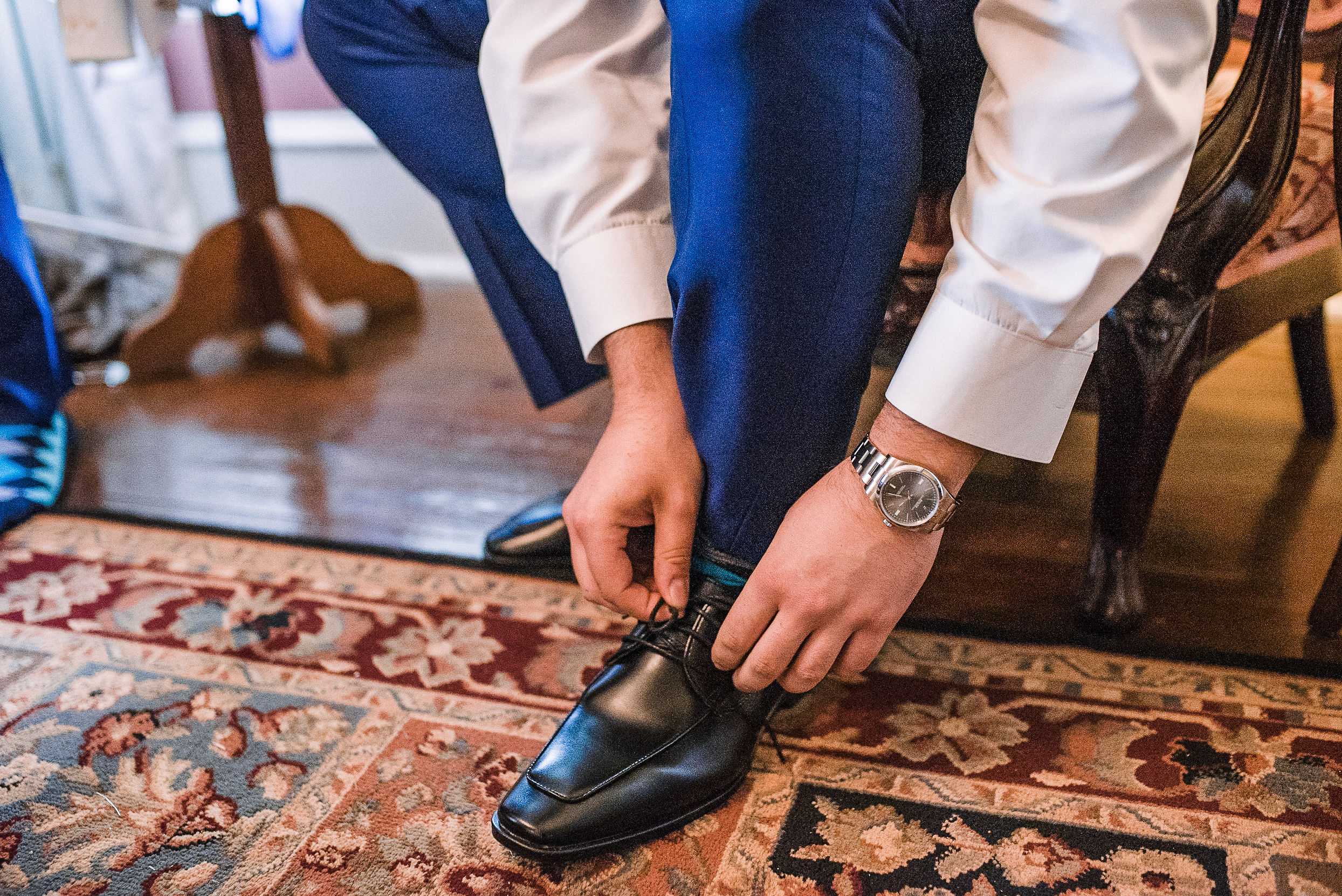 groom putting on shoes at Seasons at Magnolia Manor