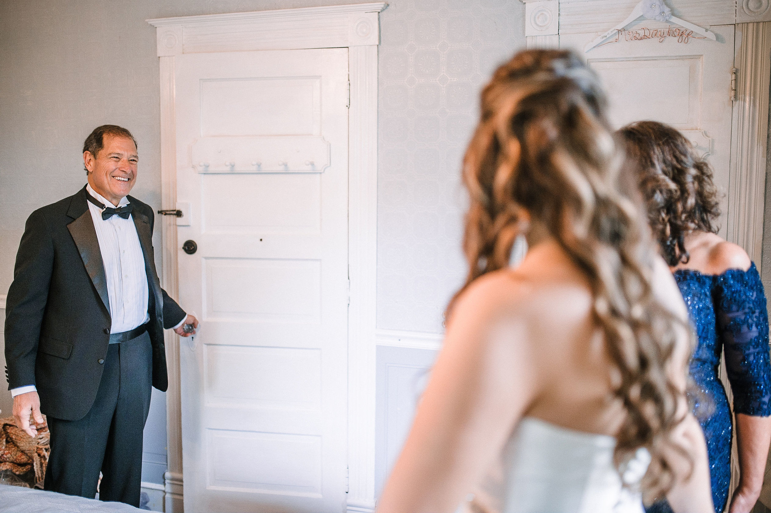 bride and father first look at Seasons at Magnolia Manor