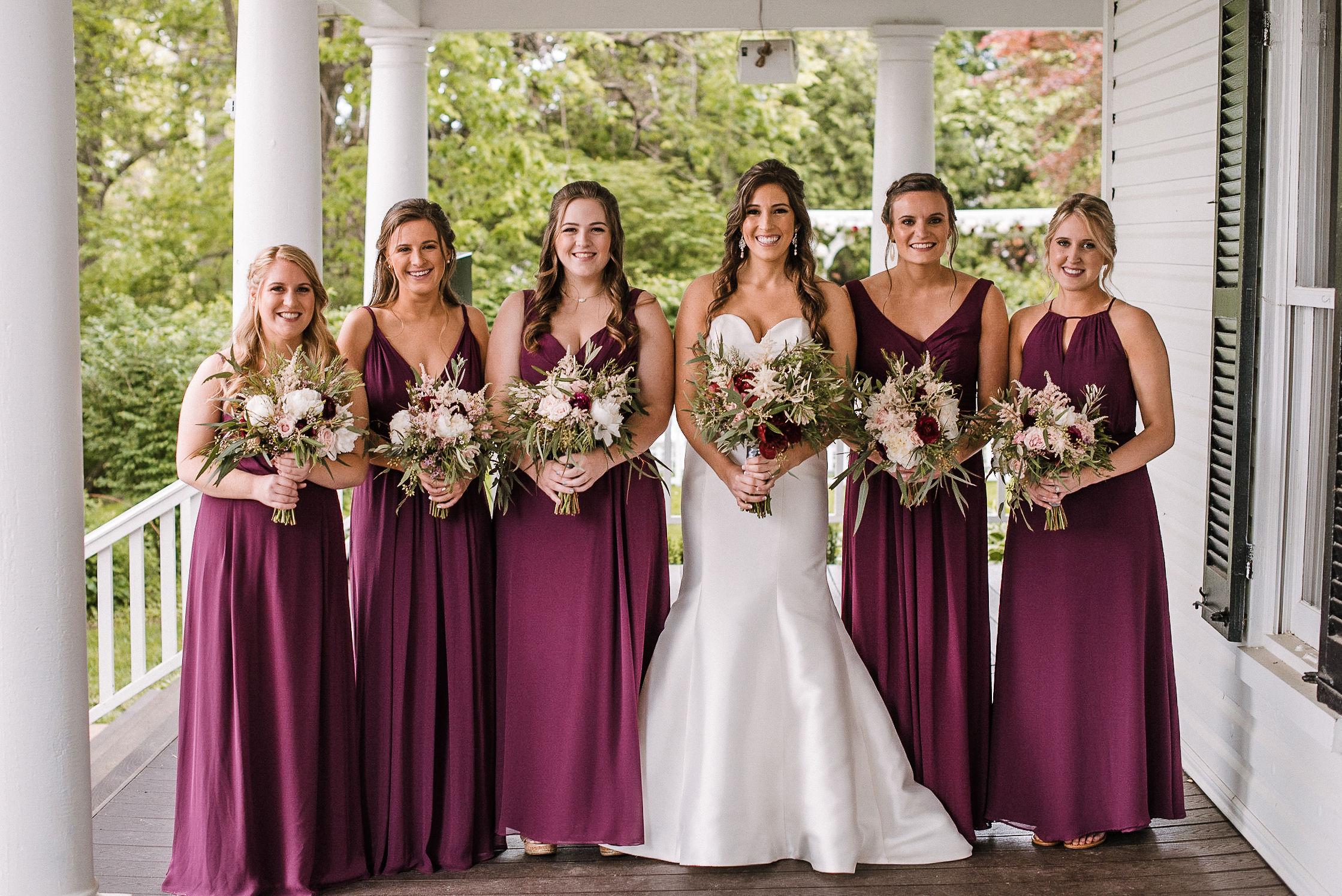 bride and bridesmaids smiling at Seasons at Magnolia Manor