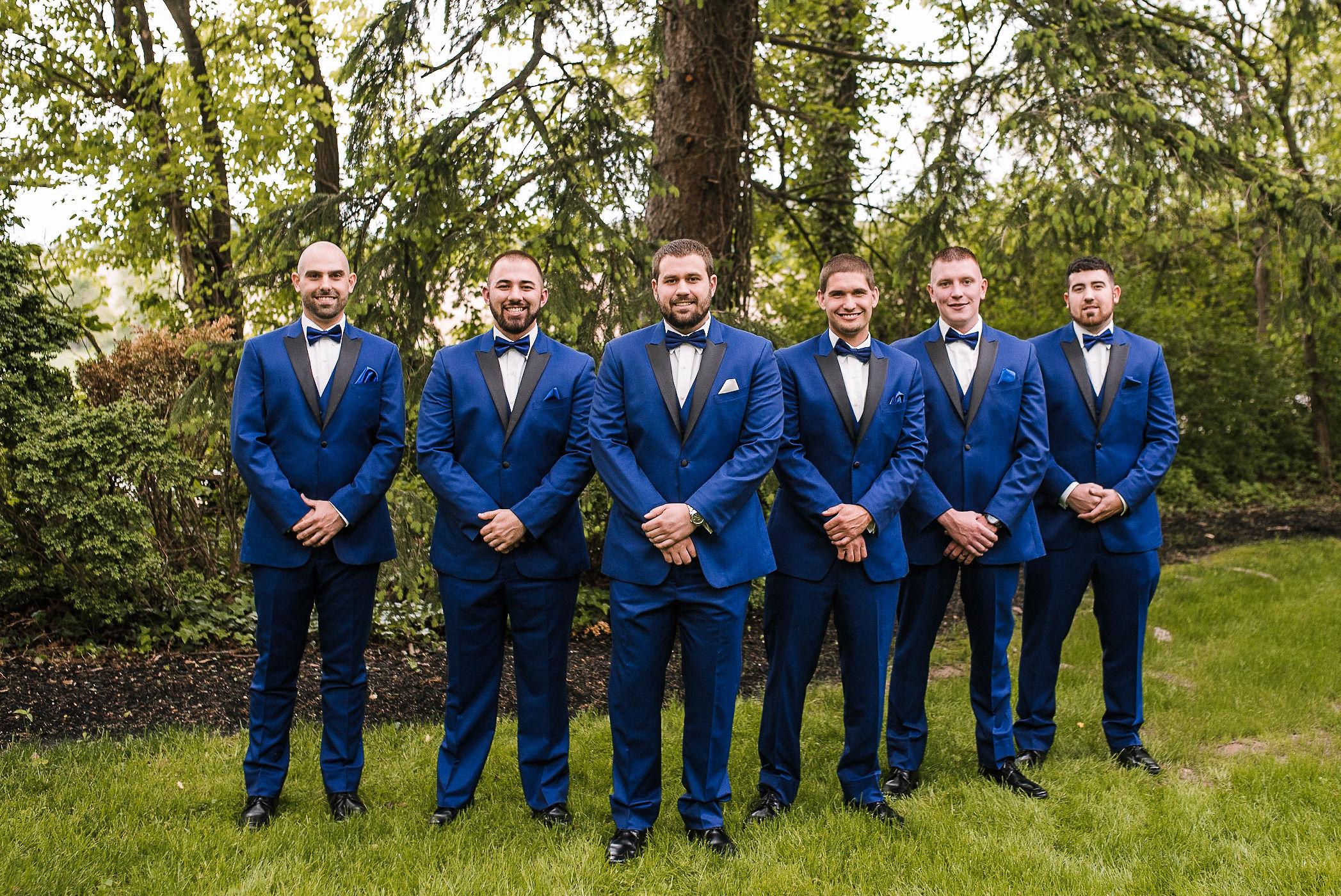 groom and groomsmen smiling at Seasons at Magnolia Manor