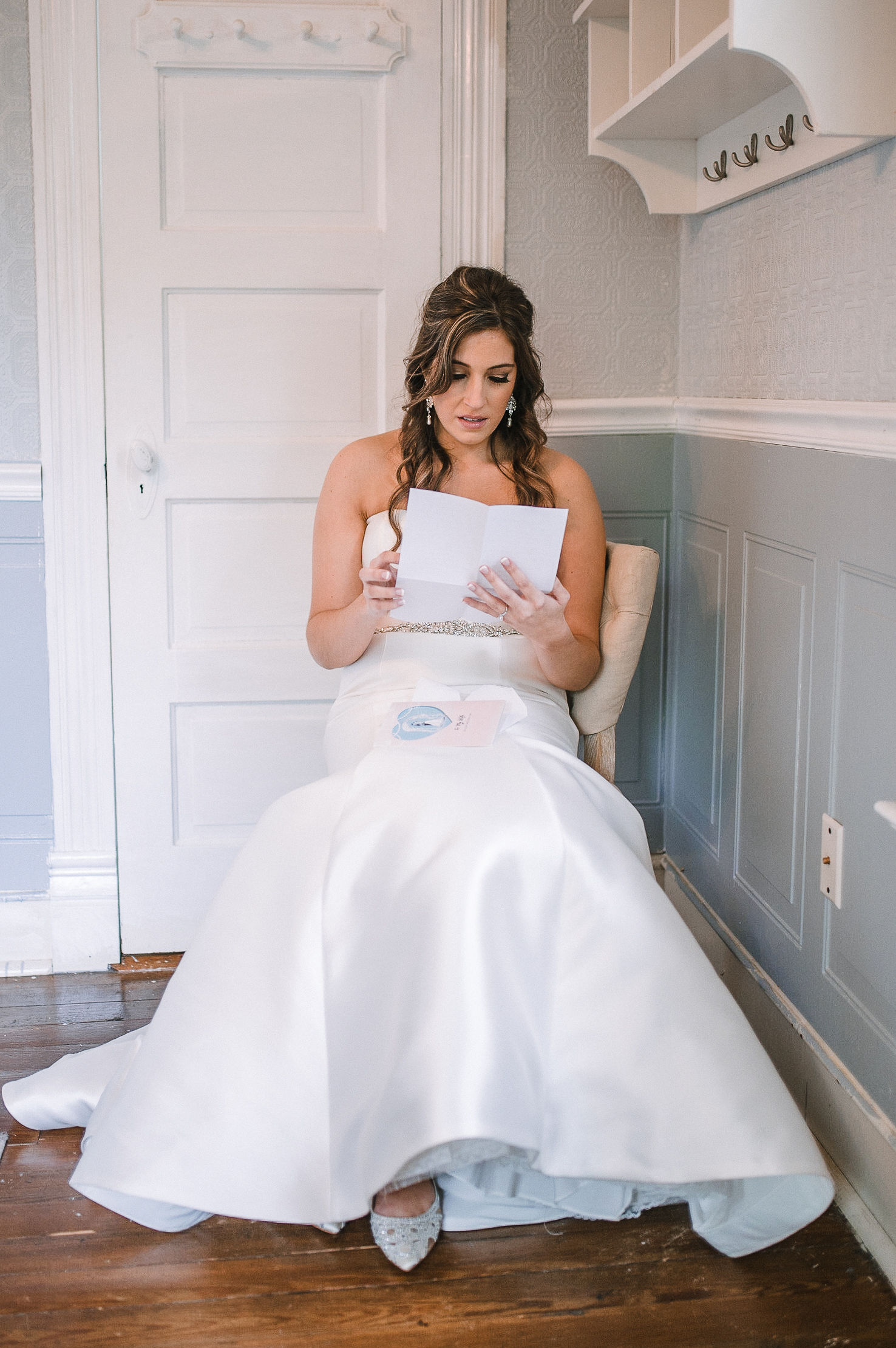 bride reading letter from groom at Seasons at Magnolia Manor