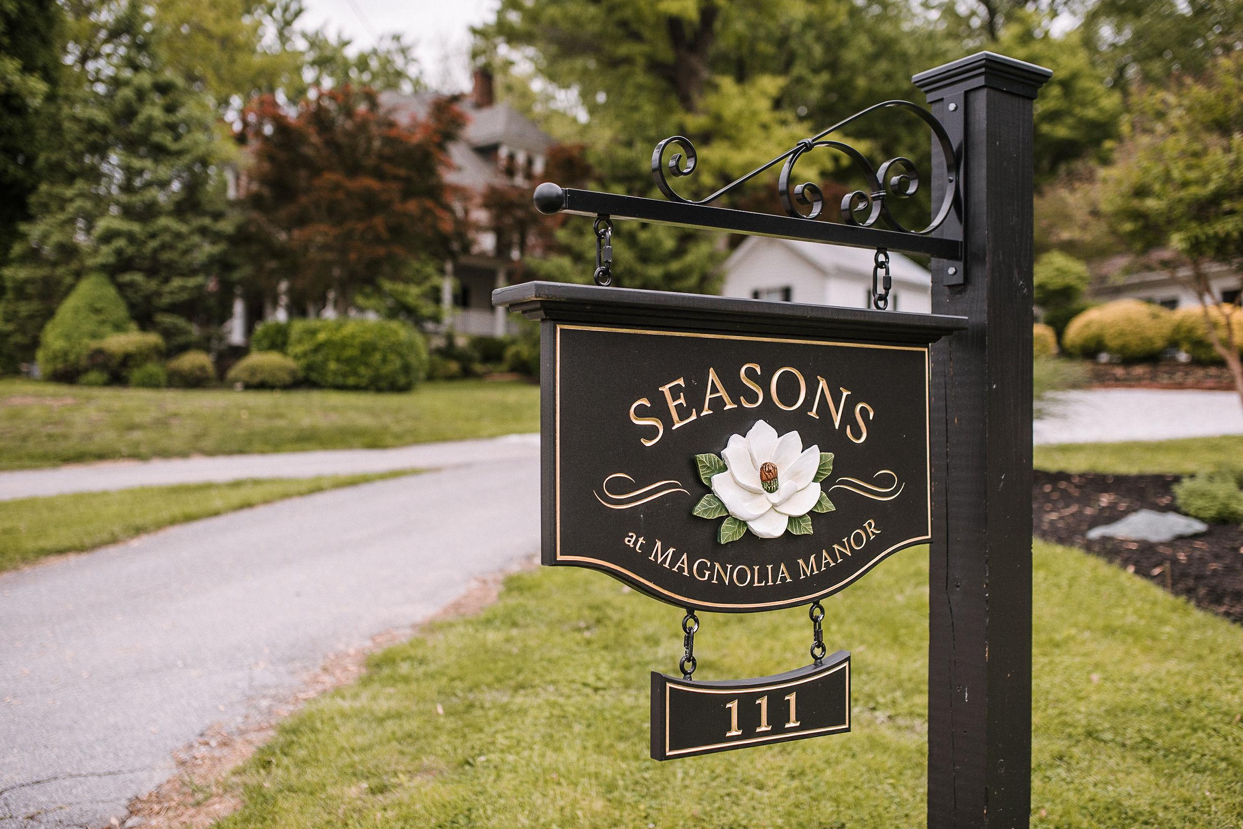 sign at venue at Seasons at Magnolia Manor