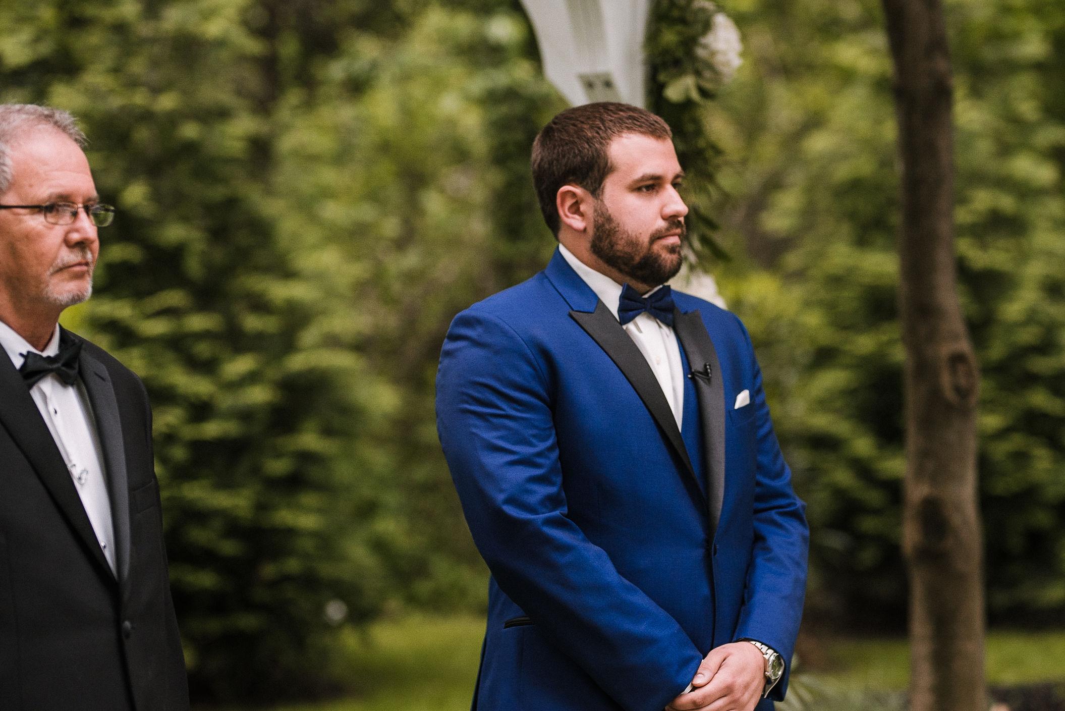 groom waiting for bride at altar at Seasons at Magnolia Manor