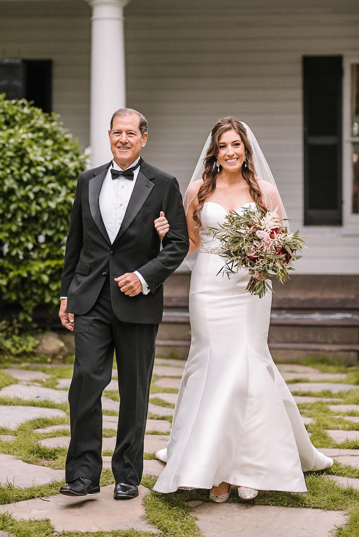 bride walking down the aisle at Seasons at Magnolia Manor