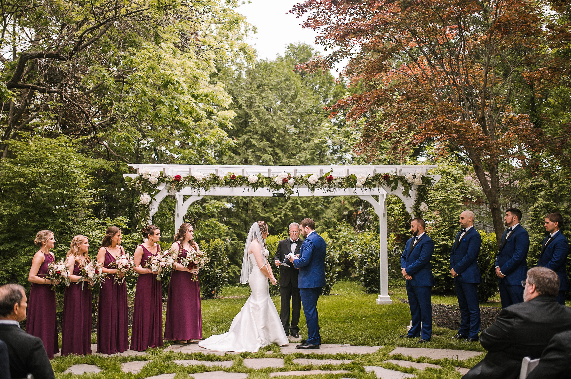bride and groom holding hands at the altar at Seasons at Magnolia Manor