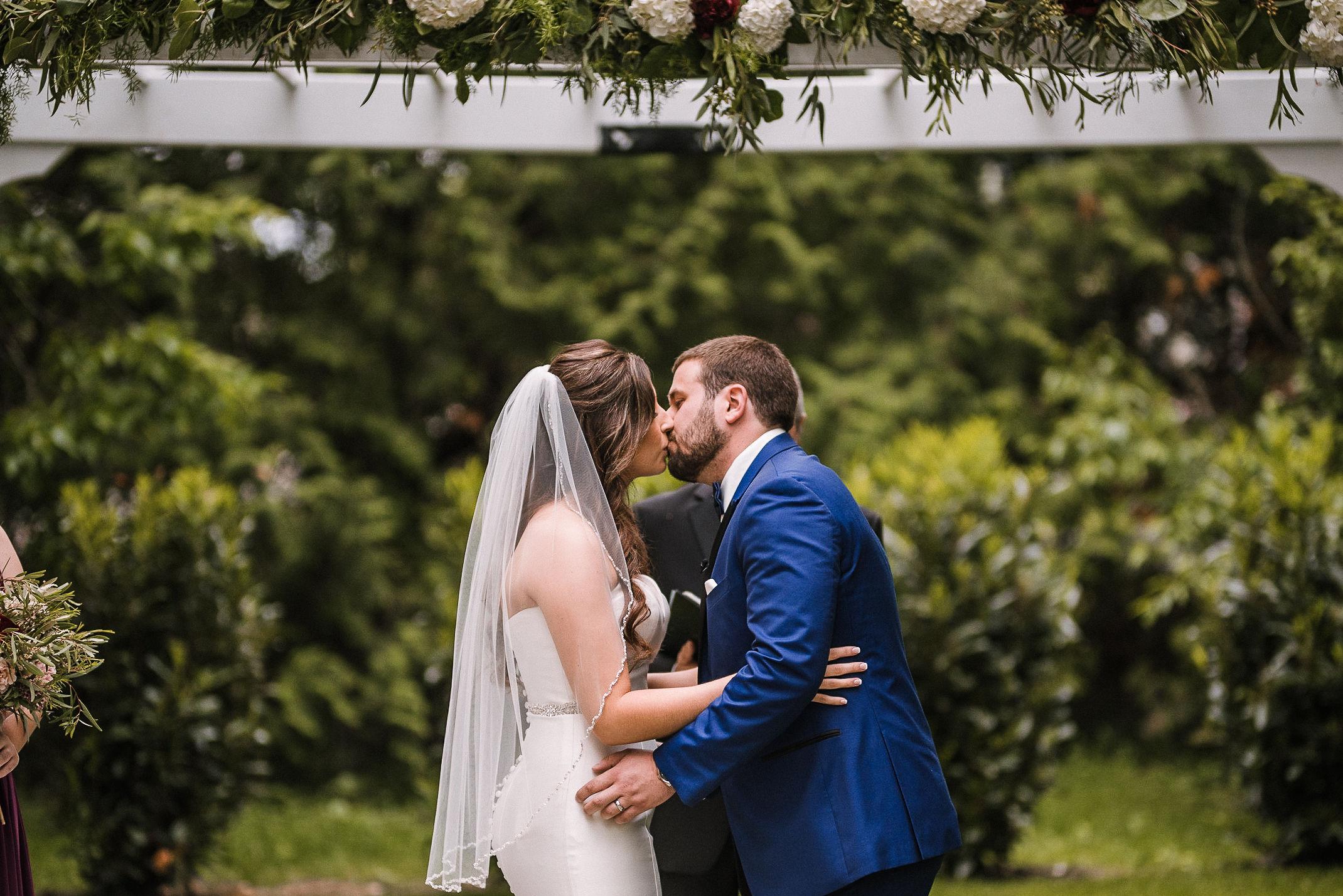 bride and groom kissing at the altar at Seasons at Magnolia Manor