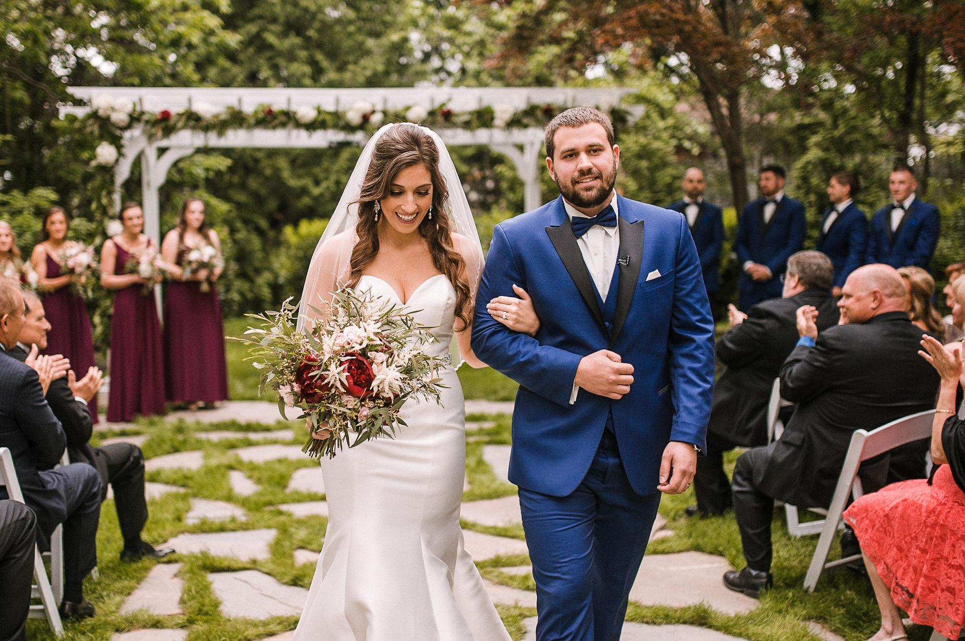bride and groom walking up the aisle at Seasons at Magnolia Manor