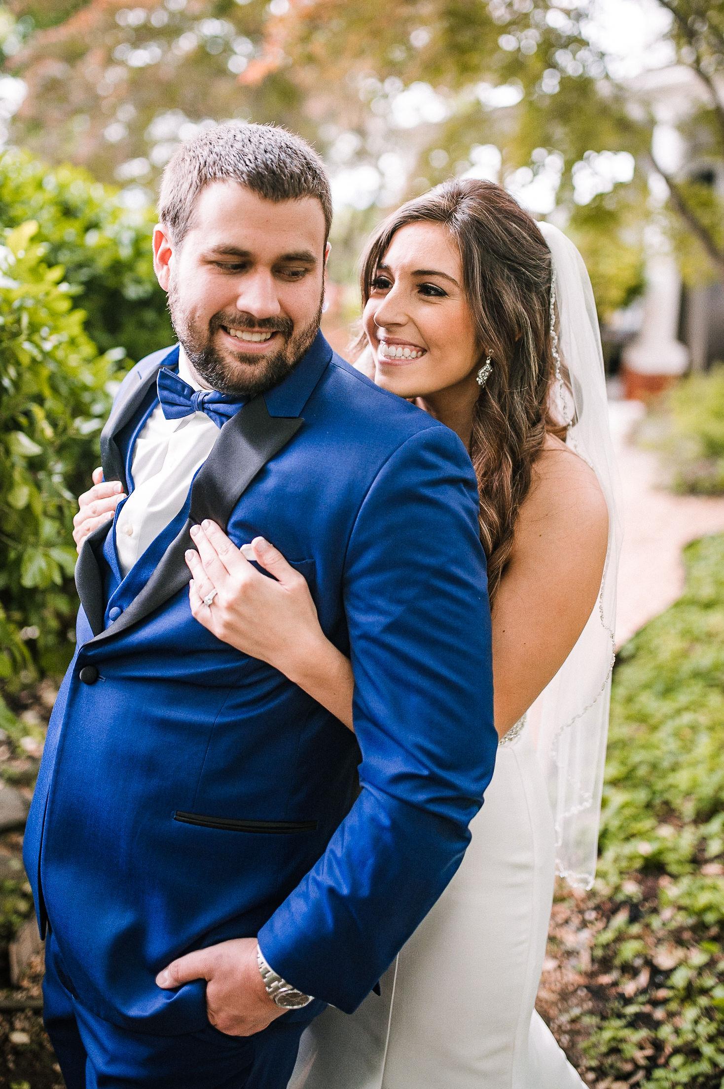 bride and groom smiling and embracing at Seasons at Magnolia Manor