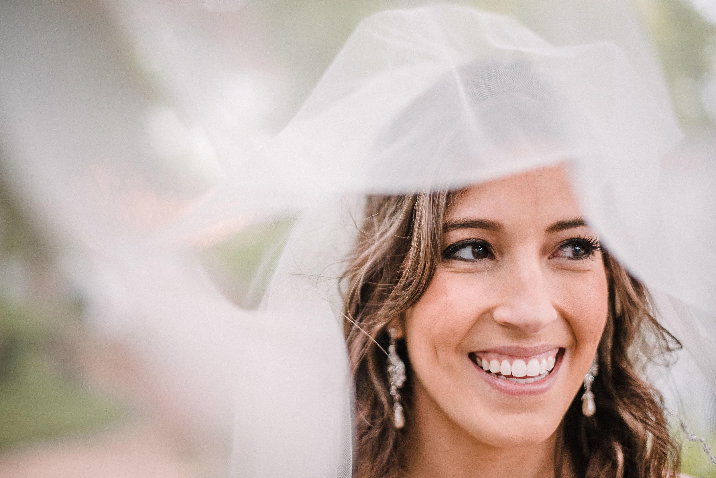bridal portrait under veil at Seasons at Magnolia Manor