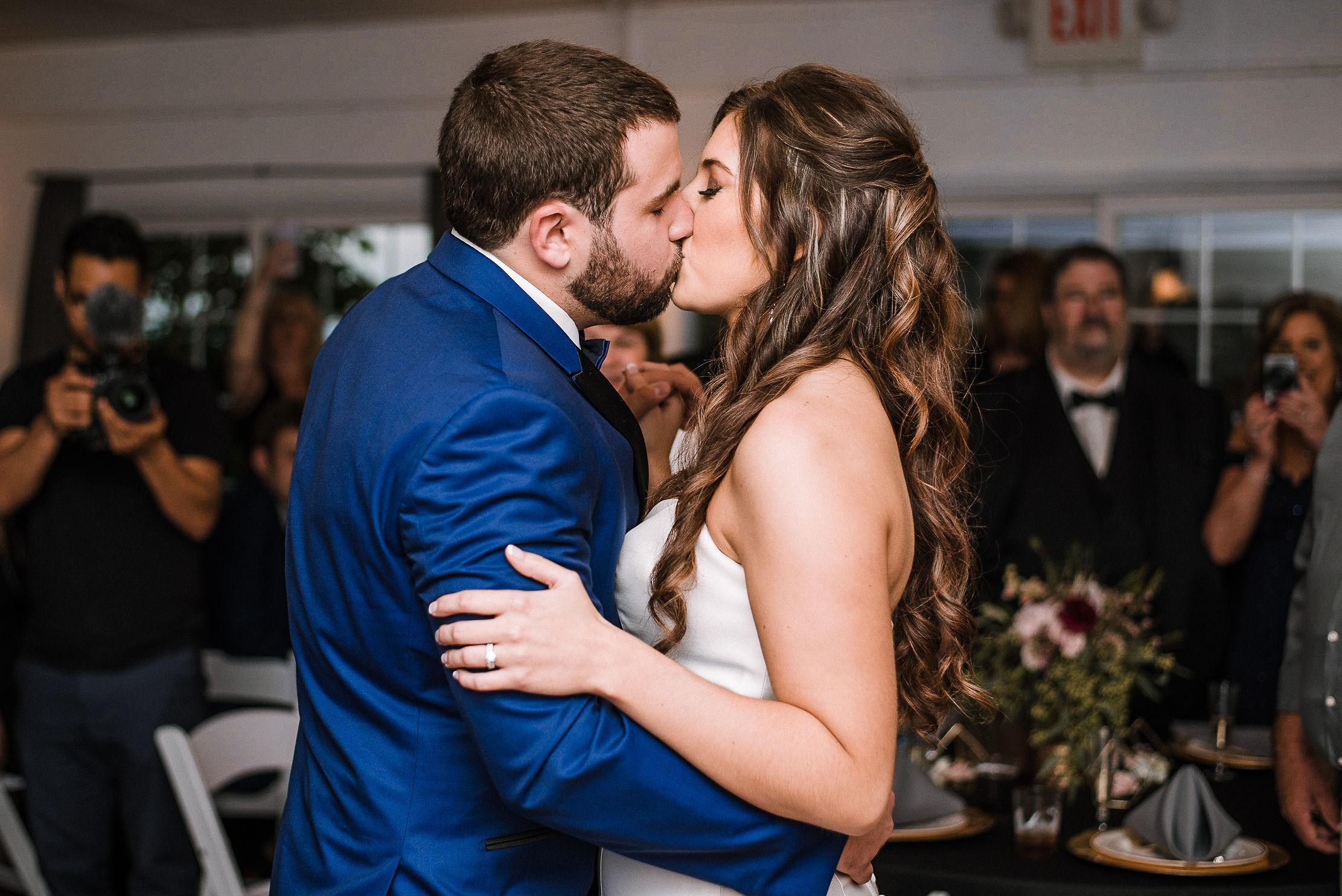 bride and groom kissing at reception at Seasons at Magnolia Manor