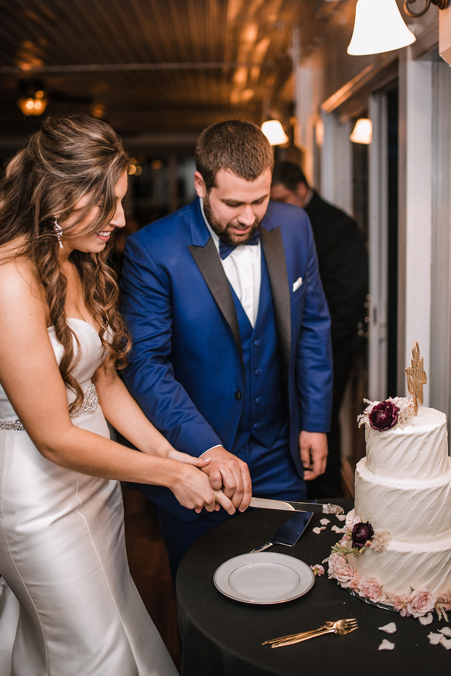 bride and groom cutting the cake at Seasons at Magnolia Manor