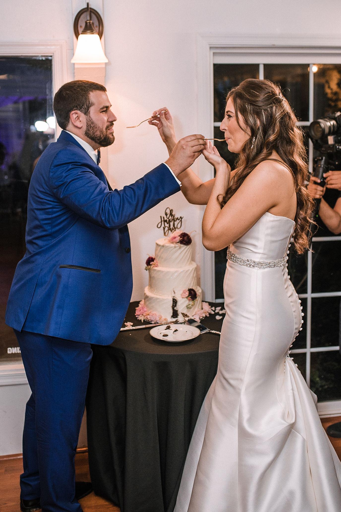bride and groom eating cake at Seasons at Magnolia Manor