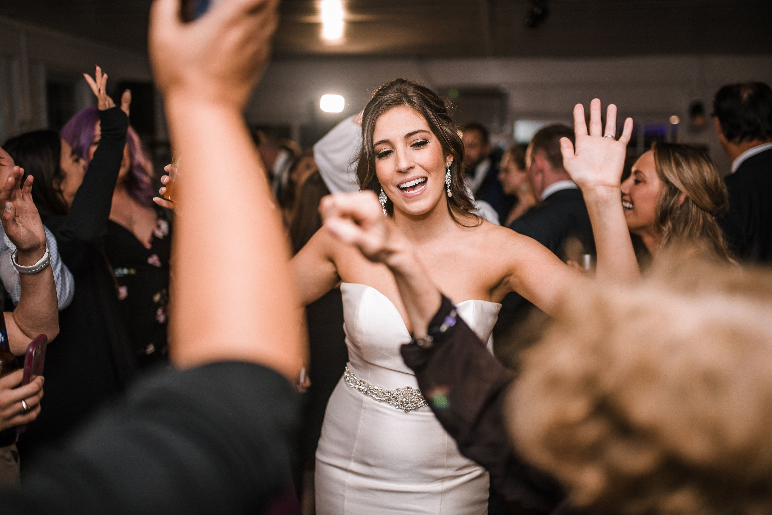bride dancing with guests at wedding reception at Seasons at Magnolia Manor