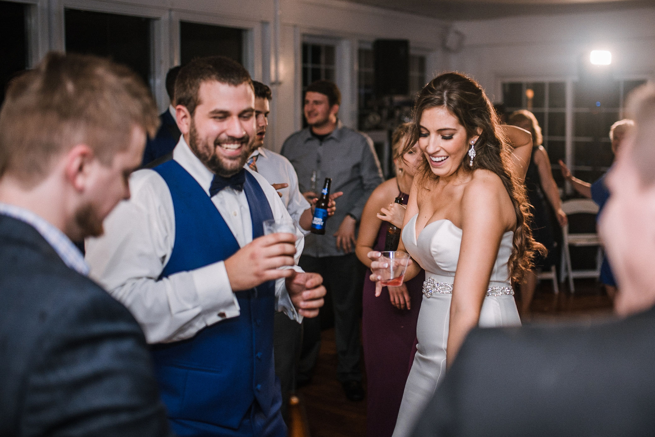 bride and groom dancing with guests at wedding reception at Seasons at Magnolia Manor