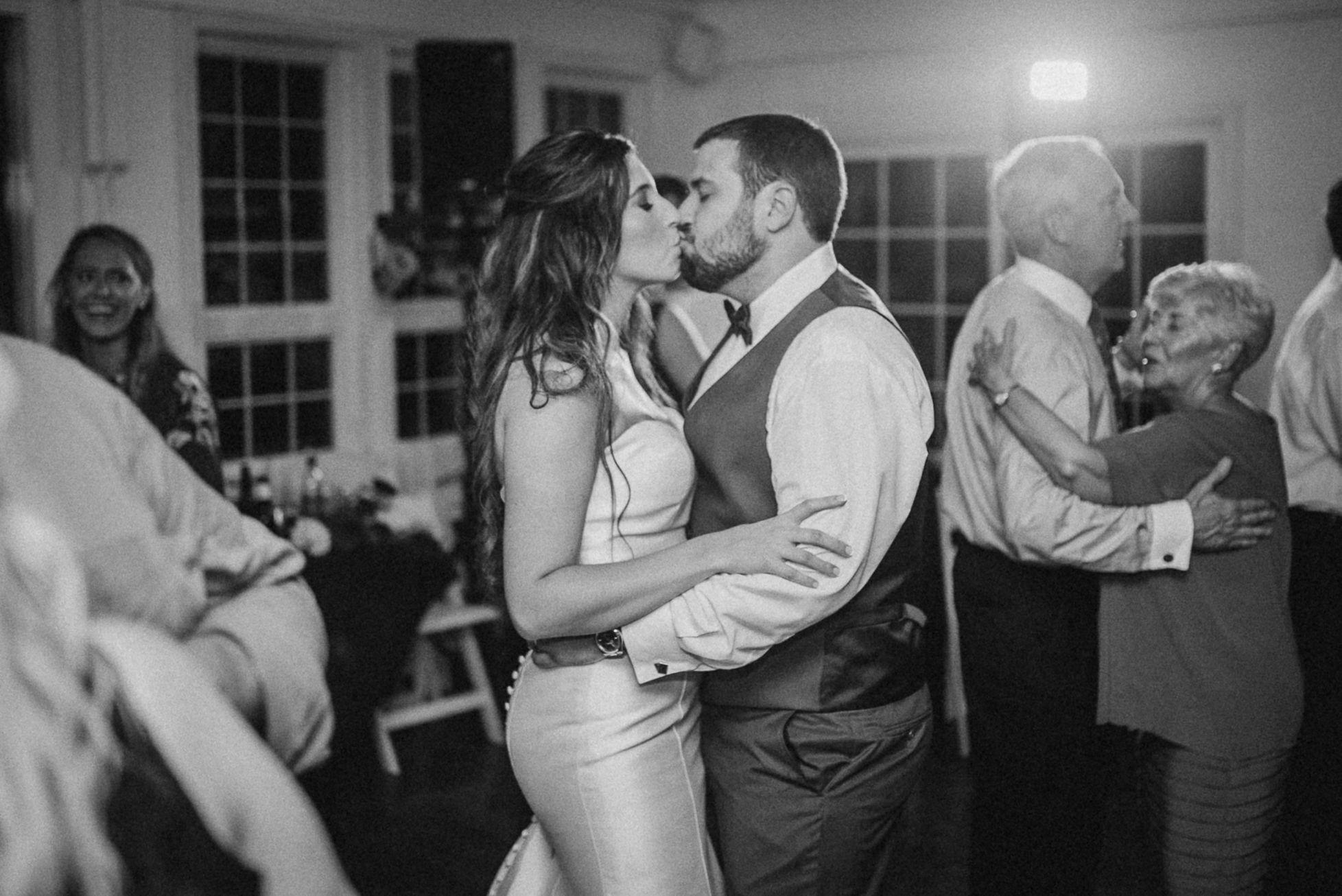 bride and groom kissing at wedding reception at Seasons at Magnolia Manor