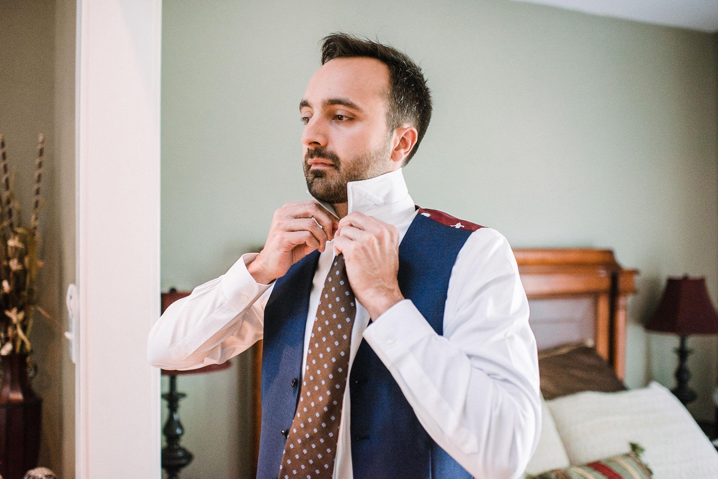 groom getting ready at House Mountain Inn & Irvine Estate