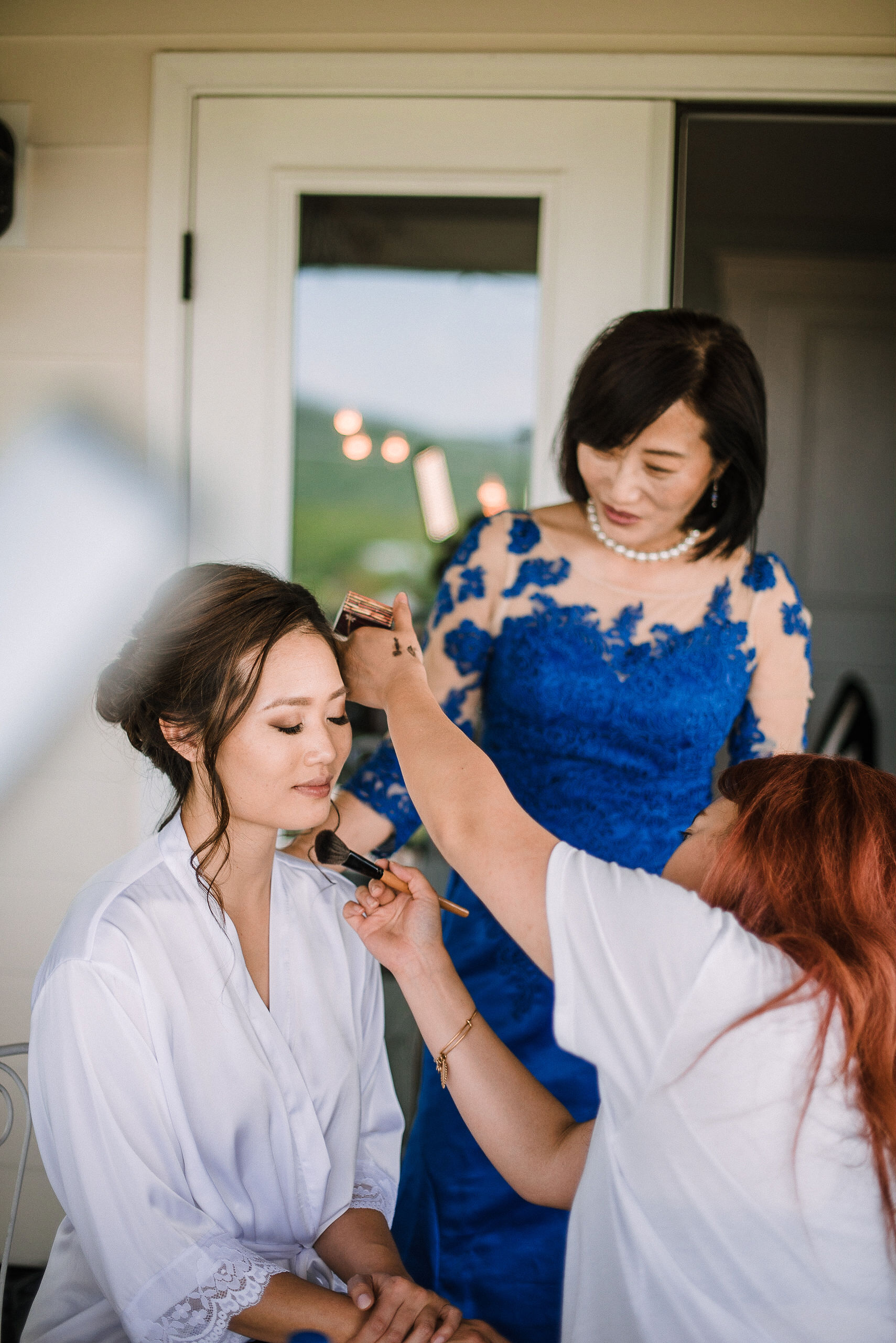 bride getting her hair and makeup done at House Mountain Inn & Irvine Estate