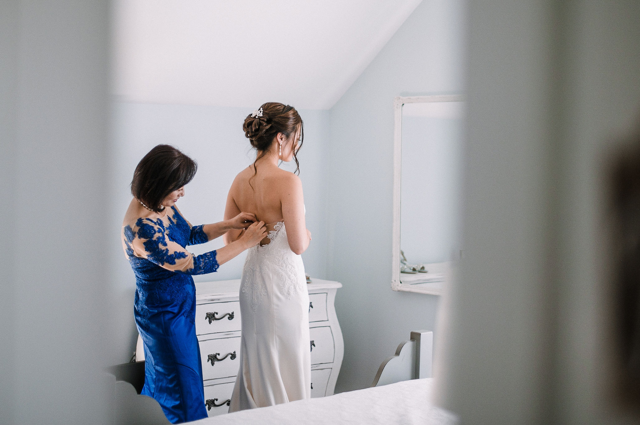 bride getting in to wedding dress at House Mountain Inn & Irvine Estate
