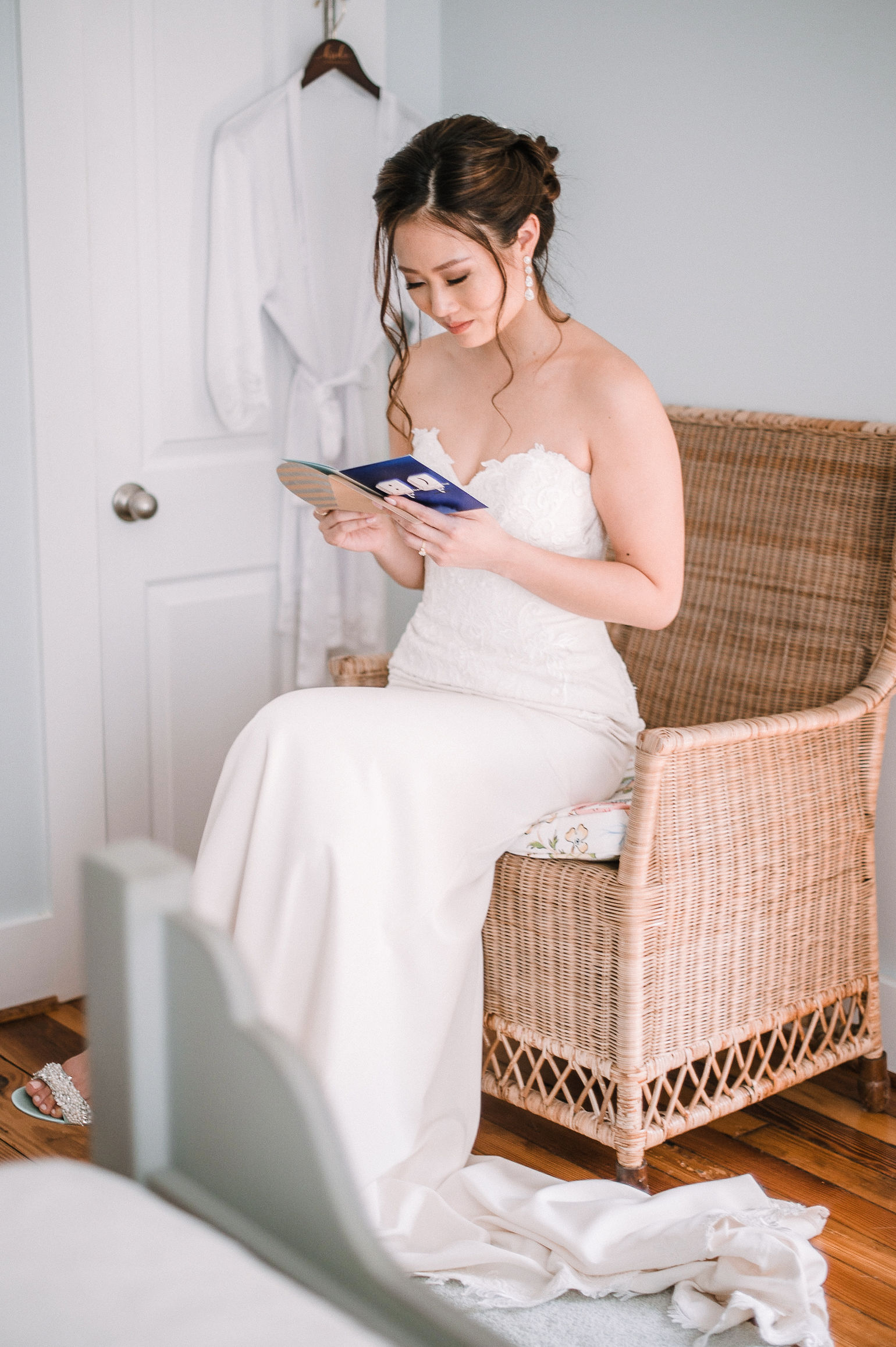 bride reading letter from groom at House Mountain Inn & Irvine Estate
