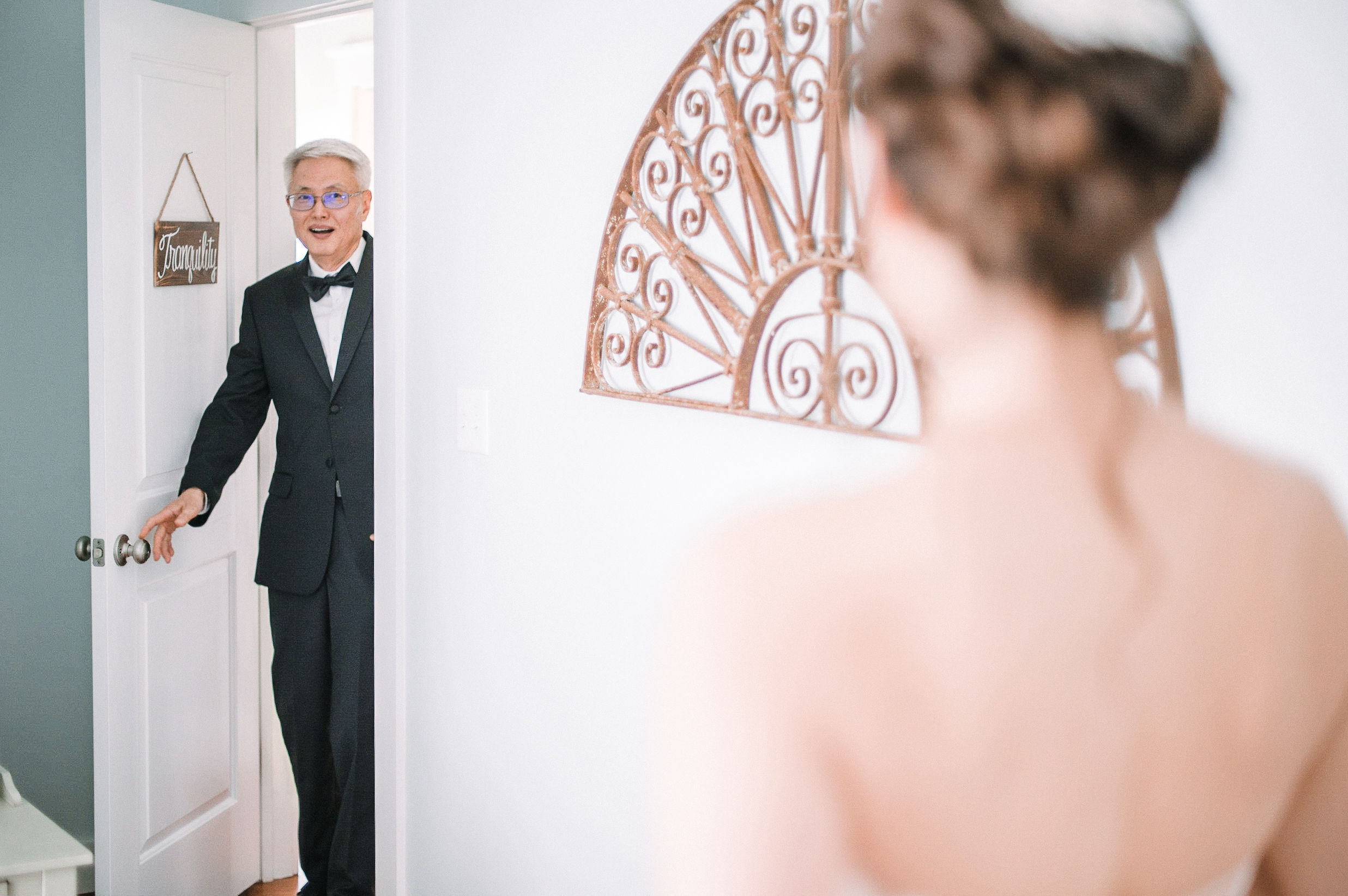 bride doing a first look with her dad at House Mountain Inn & Irvine Estate