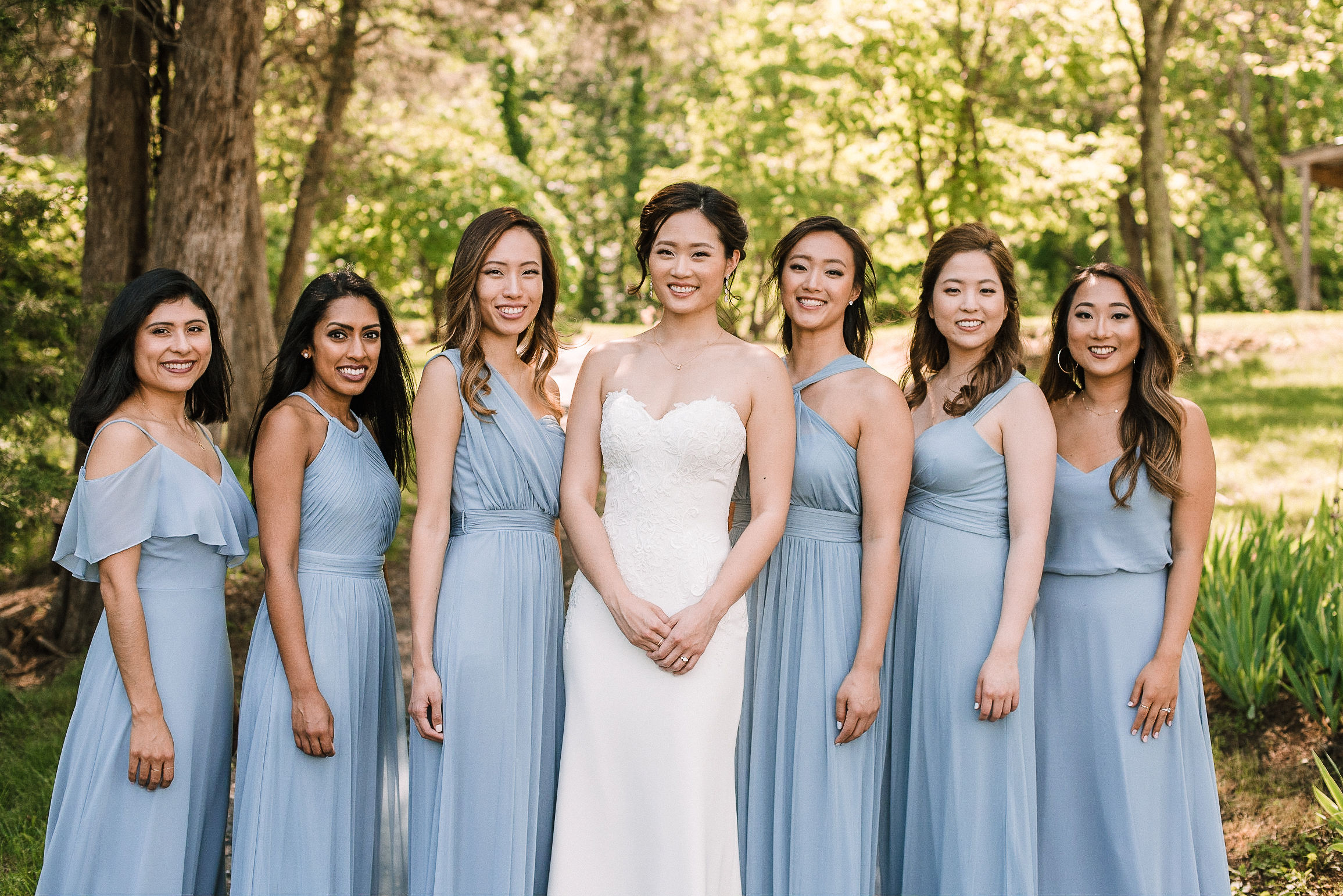 bride and bridesmaids smiling at House Mountain Inn & Irvine Estate