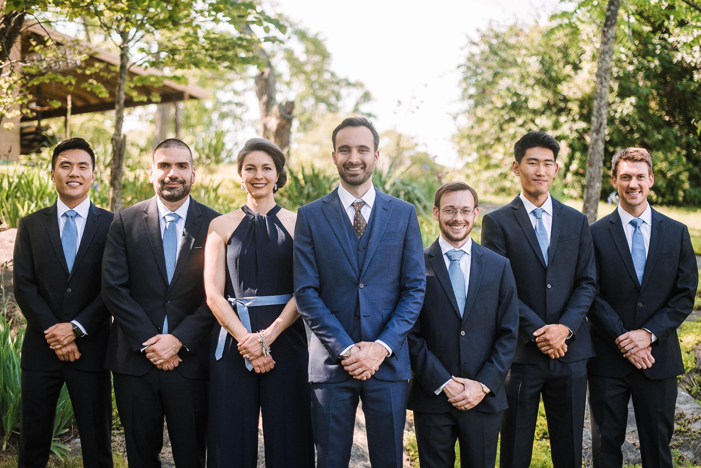 groom and groomsmen smiling at House Mountain Inn & Irvine Estate