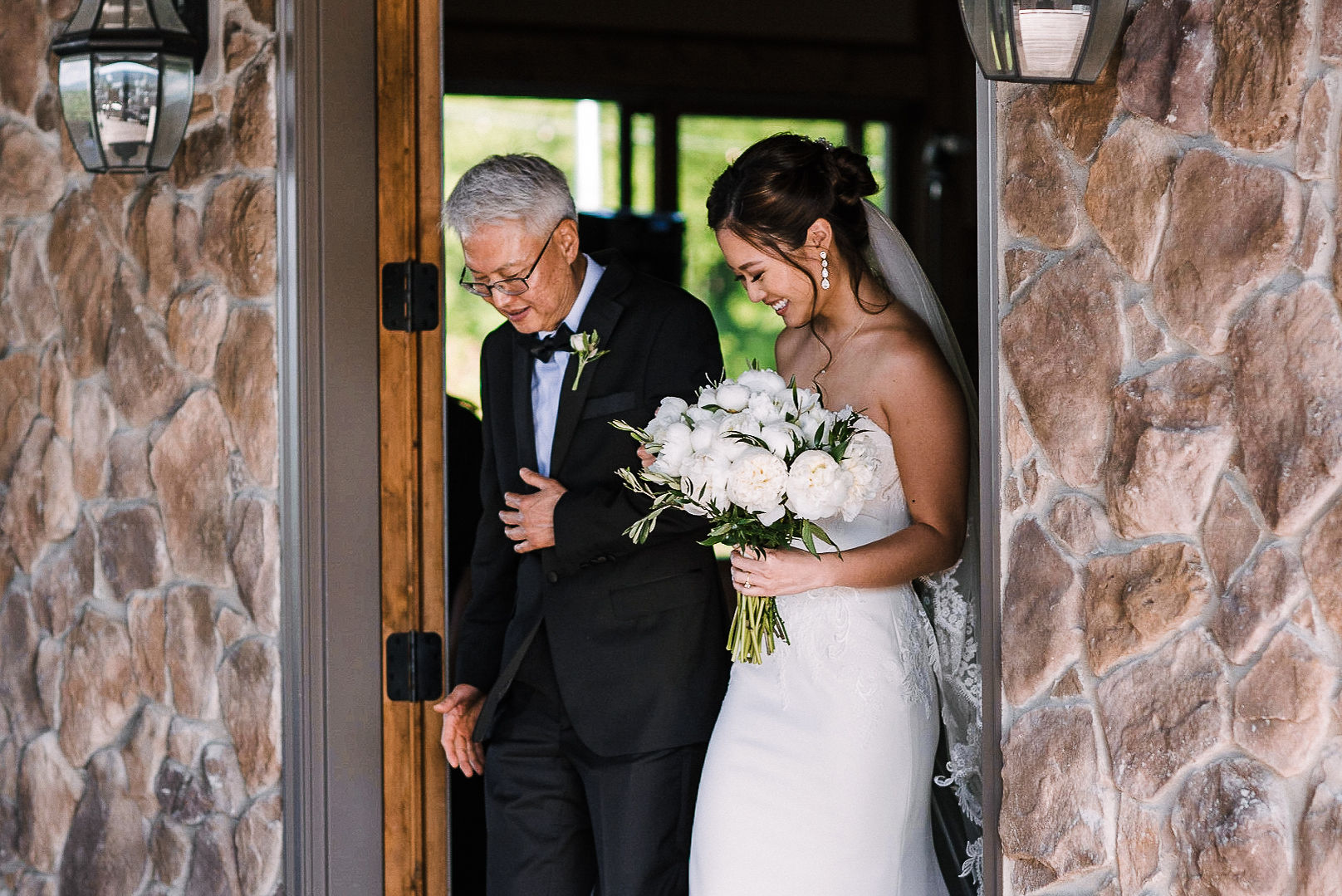 bride coming down the aisle at House Mountain Inn & Irvine Estate