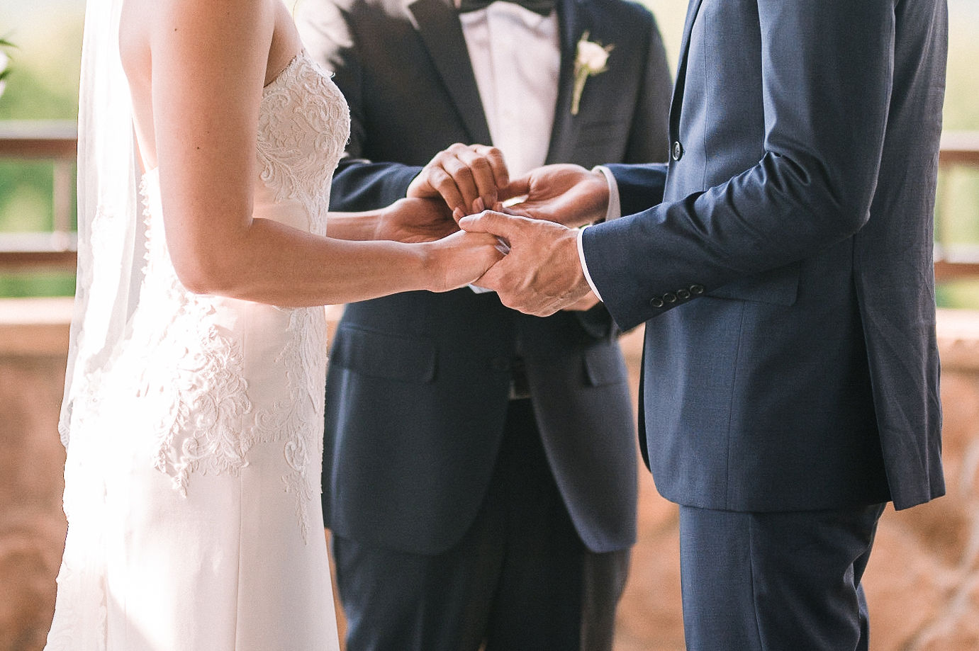 bride and groom holding hands during ceremony at House Mountain Inn & Irvine Estate