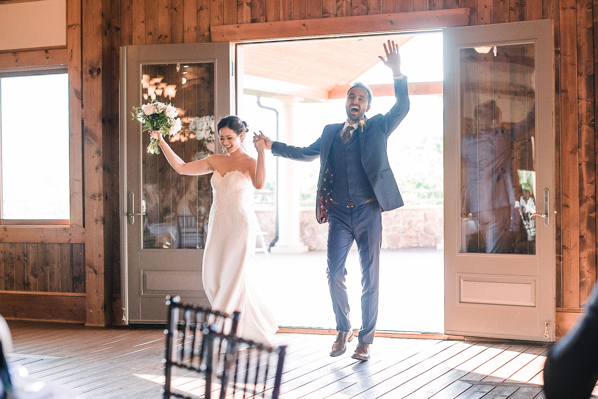 bride and groom entering reception at House Mountain Inn & Irvine Estate