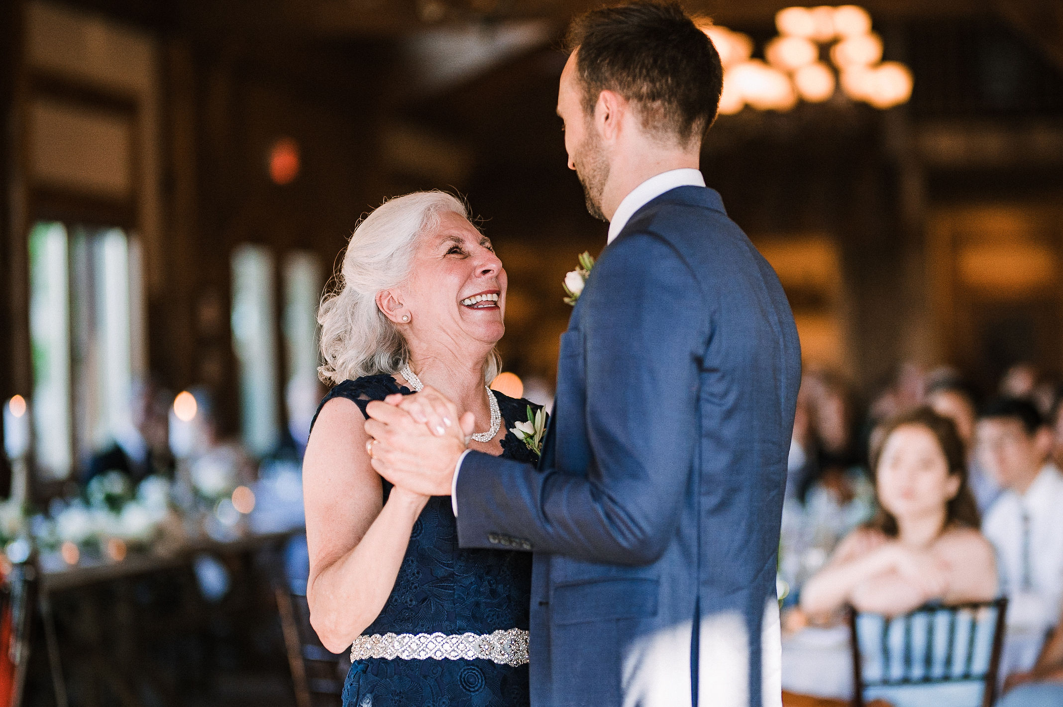 groom having first dance with his mom at House Mountain Inn & Irvine Estate