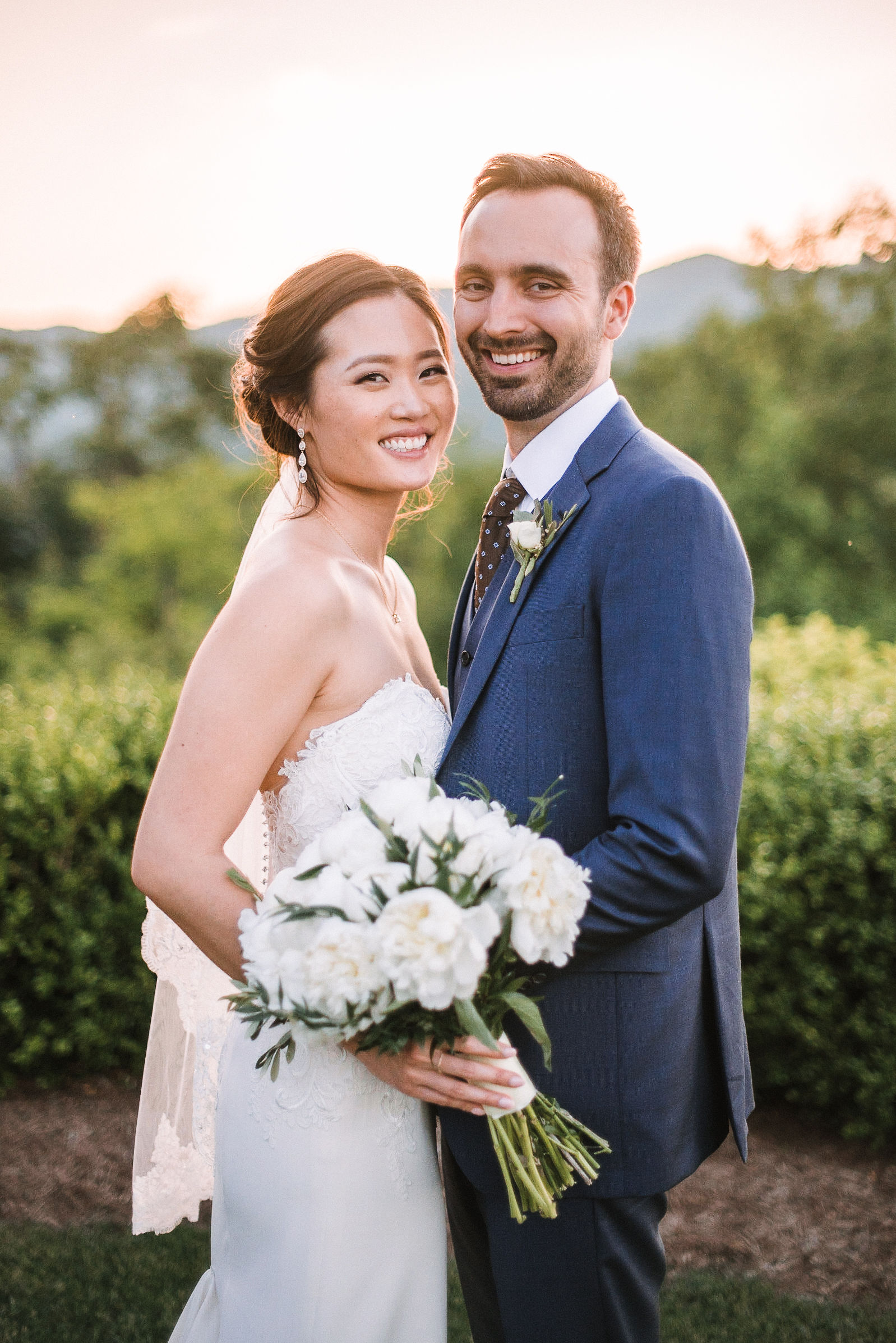 bride and groom smiling at House Mountain Inn & Irvine Estate