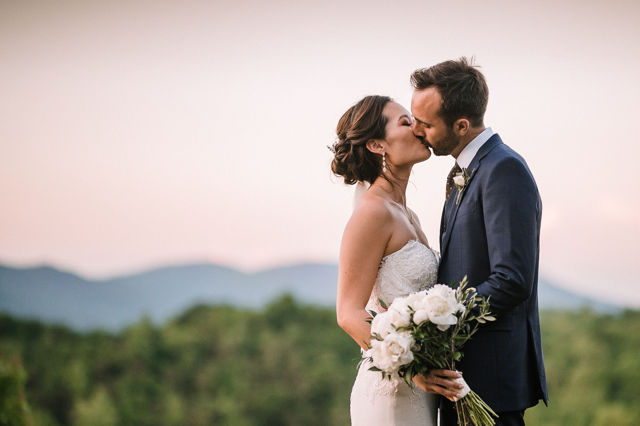 bride and groom kissing at House Mountain Inn & Irvine Estate