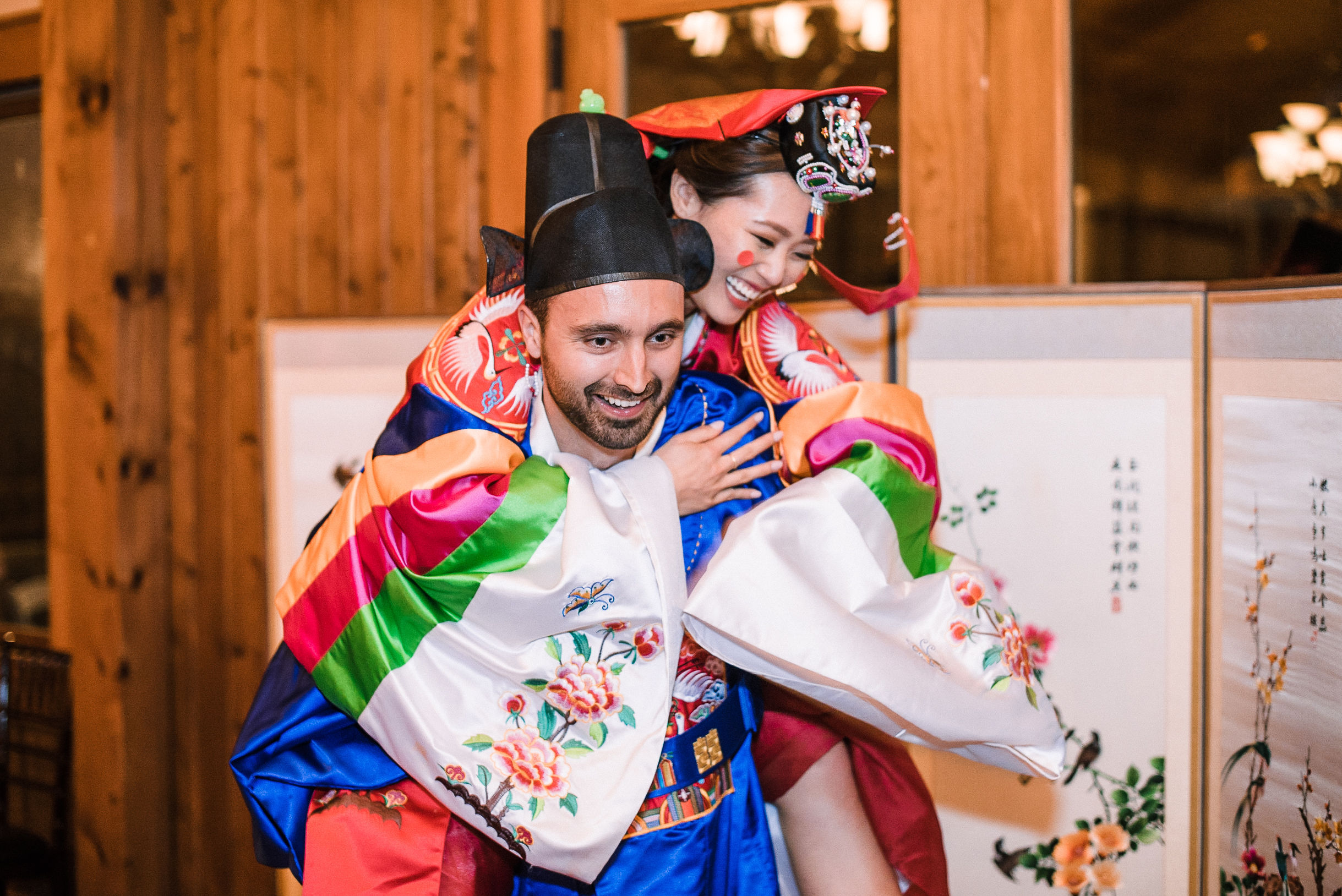 bride and groom performing traditional korean ceremony