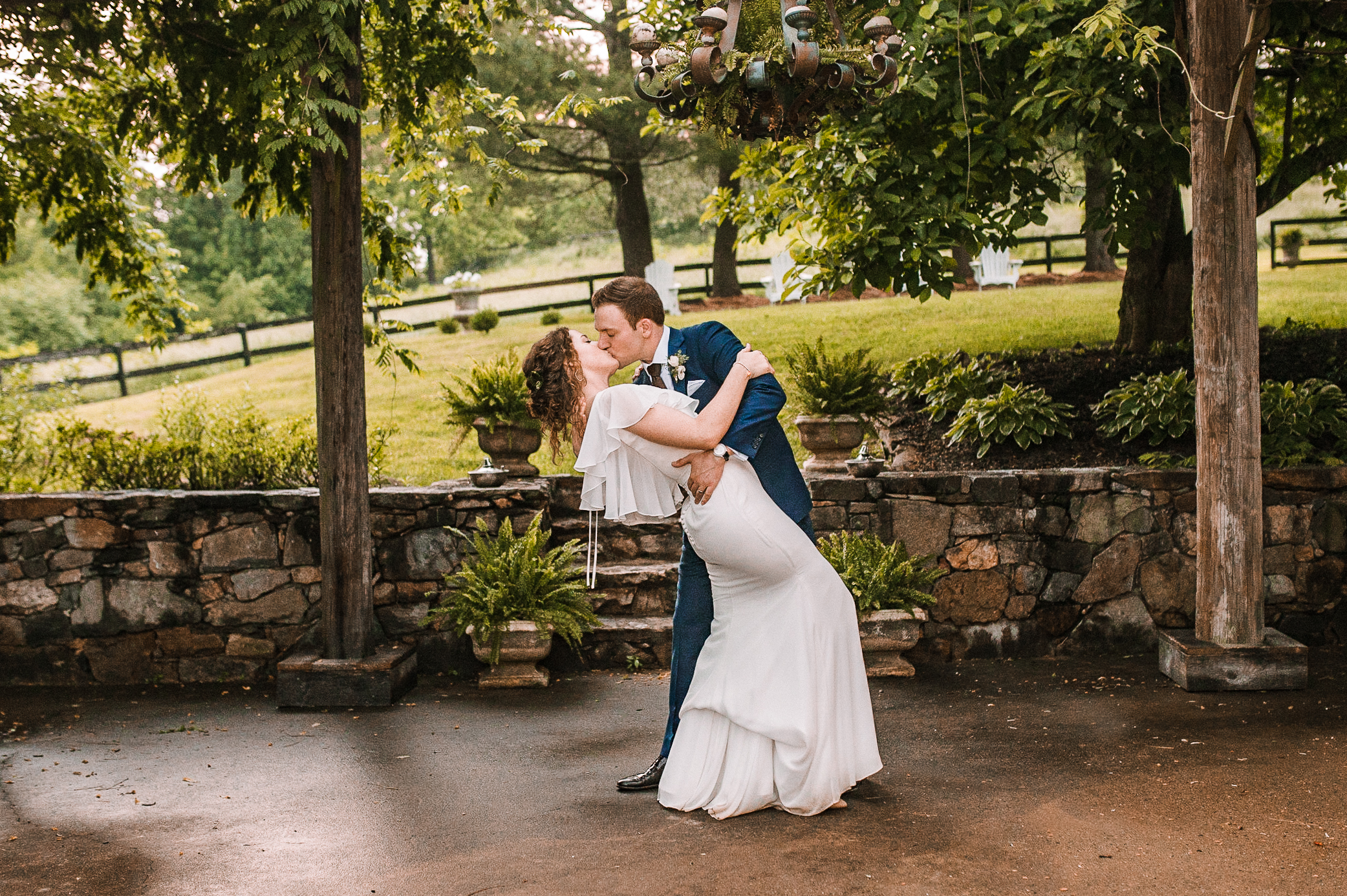 bride and groom kissing at tranquility farm