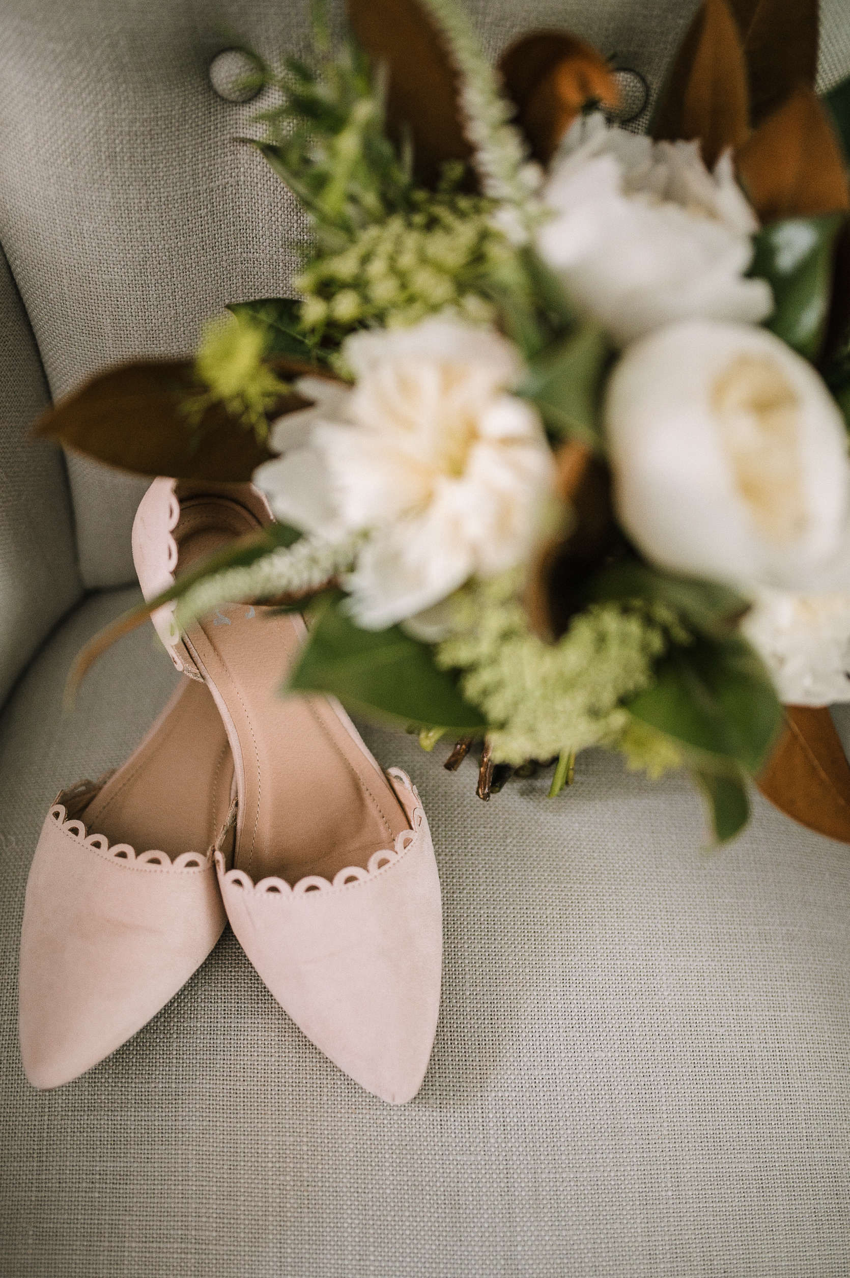 bridal shoes and bouquet shot at tranquility farm