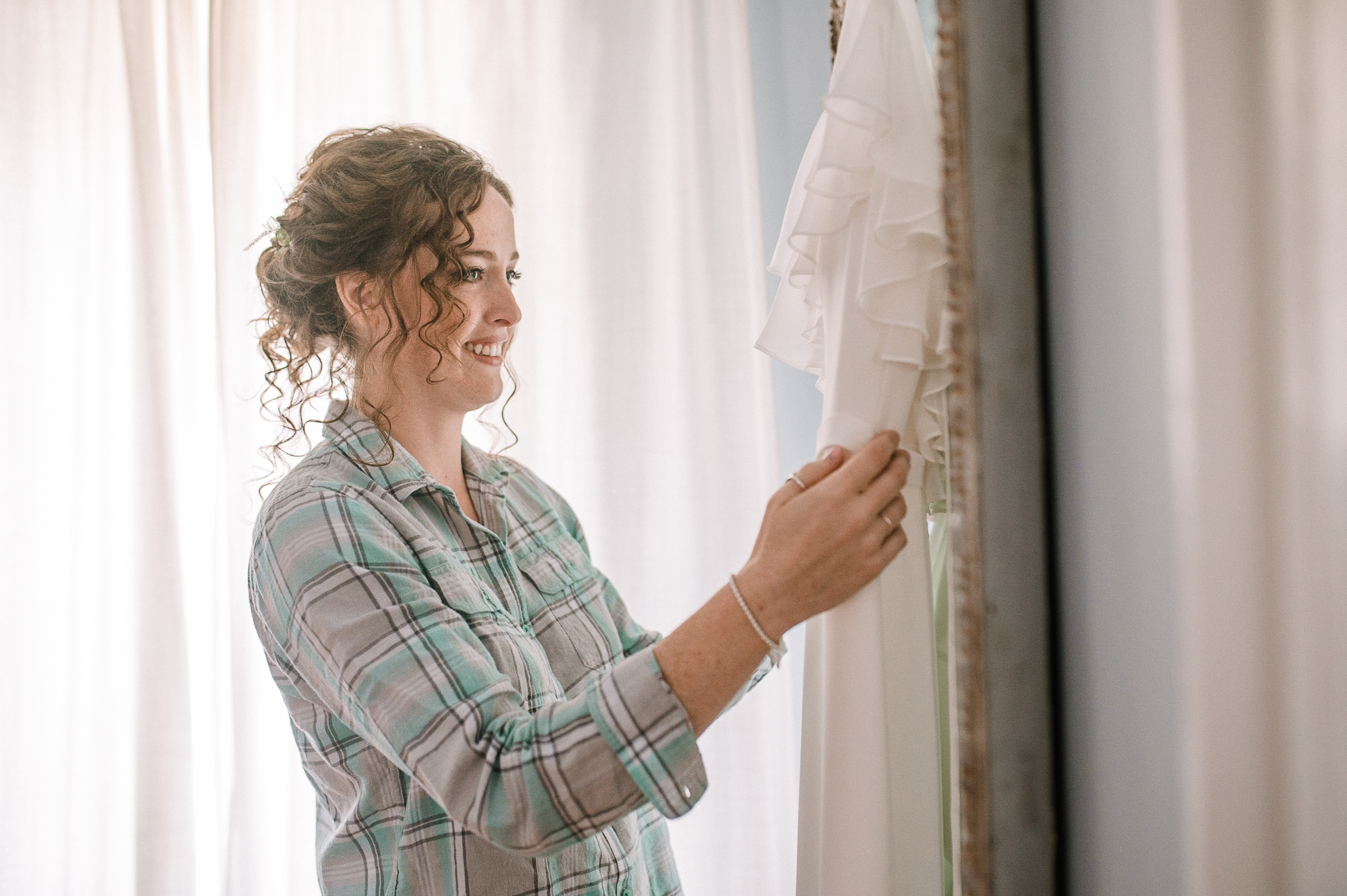 bride looking at her wedding dress at tranquility farm