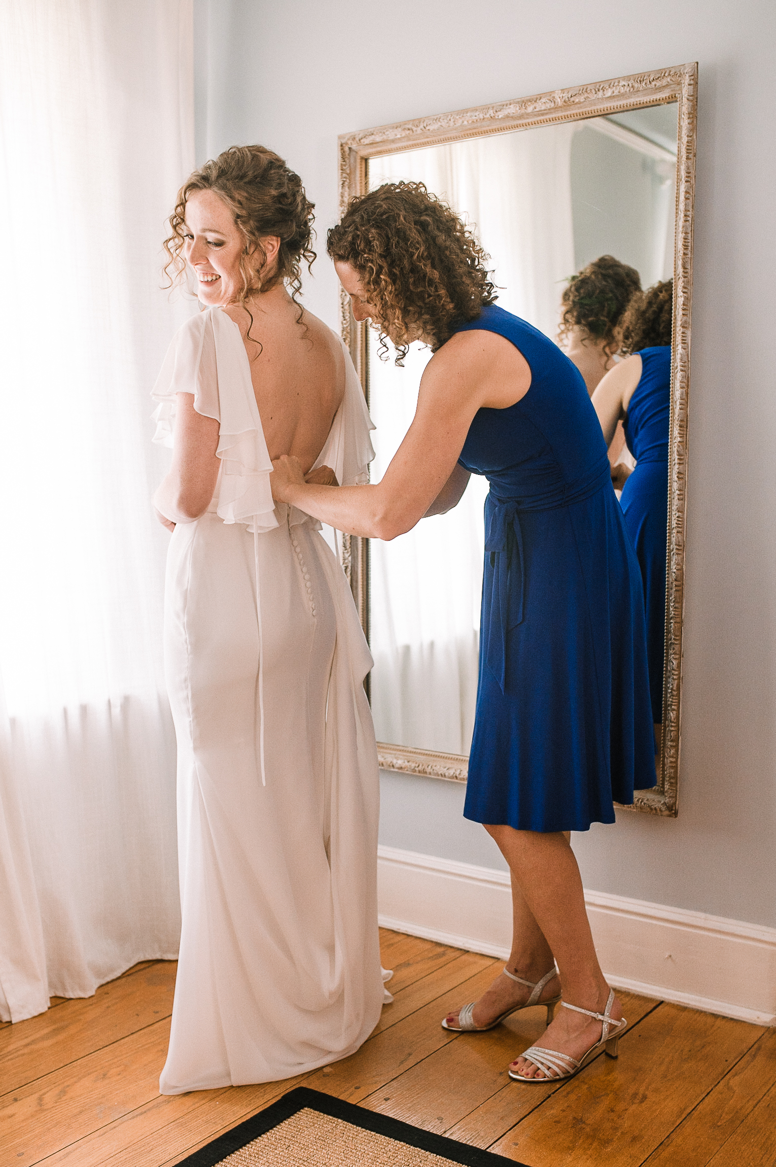 bride getting in to wedding dress at tranquility farm